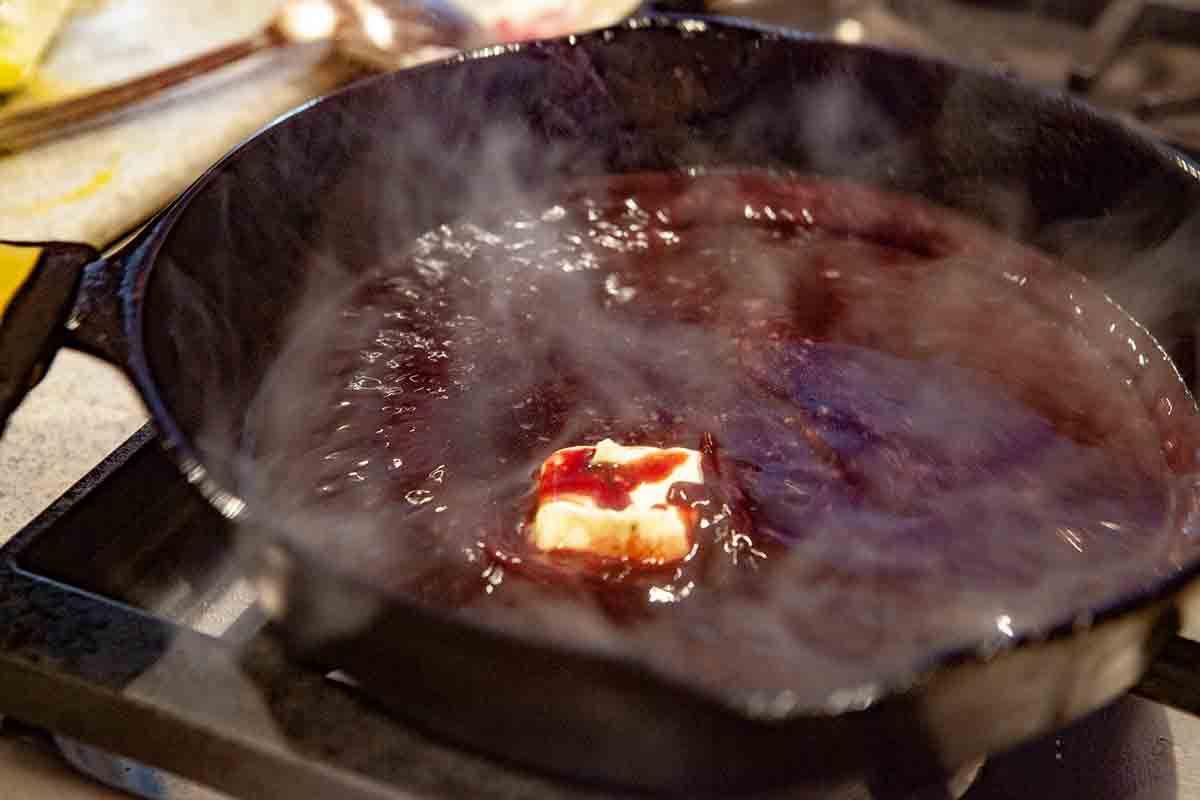 swirl butter into filet mignon wine sauce in pan