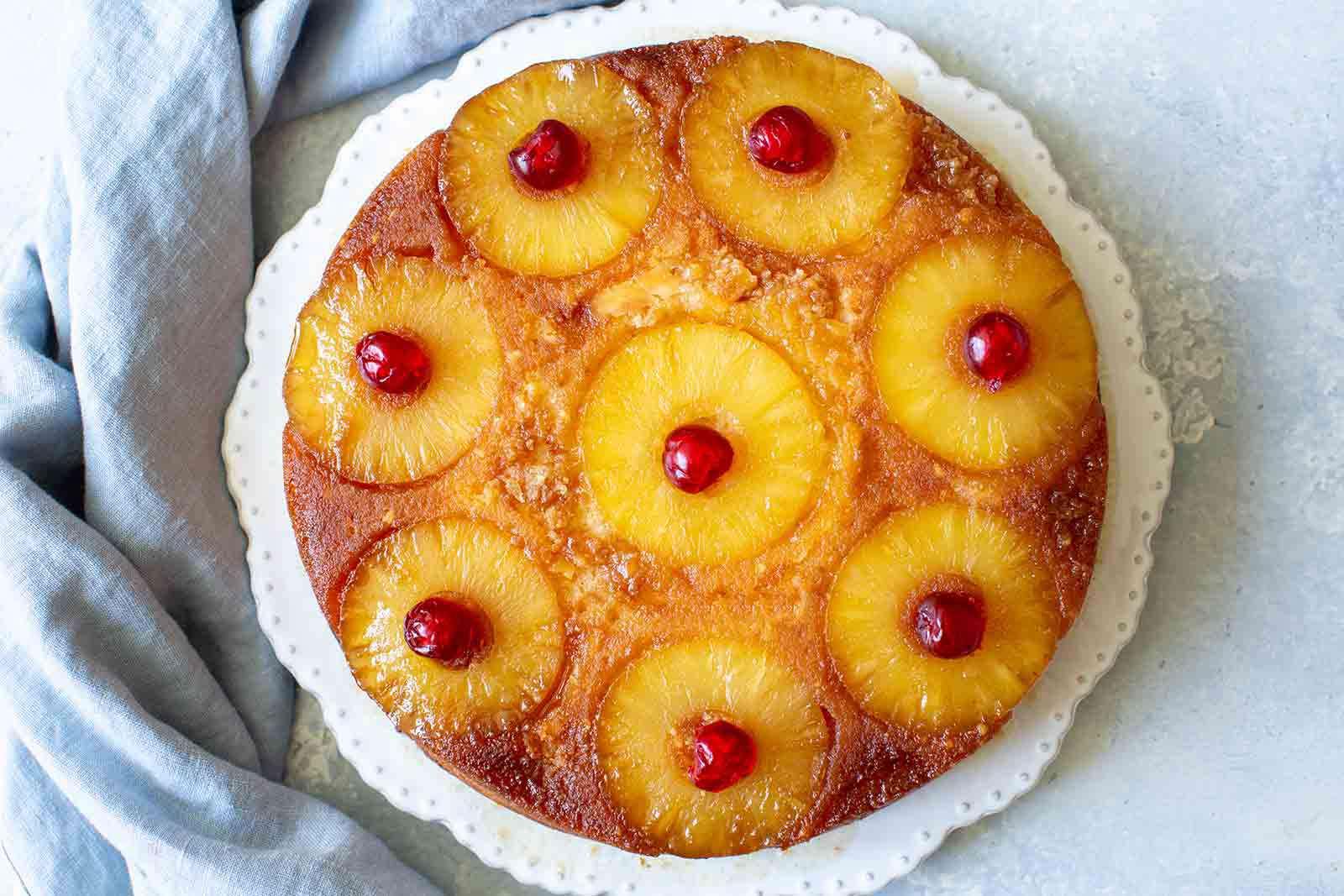 Pineapple Upside Down Cake in pan with cherries
