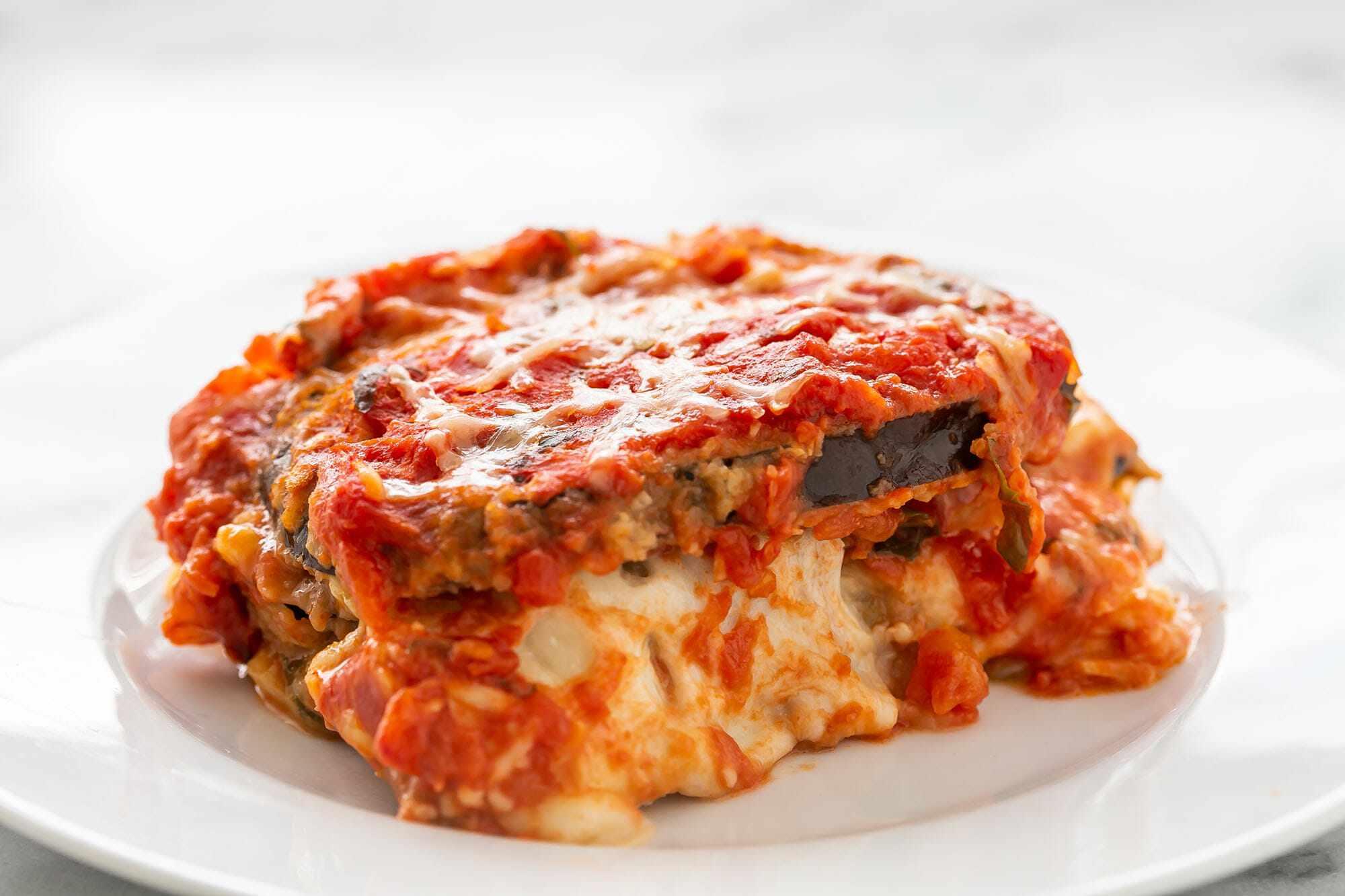 Slice of eggplant parmesan on a plate
