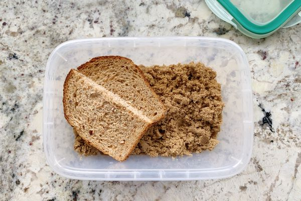 brown sugar container with piece of bread