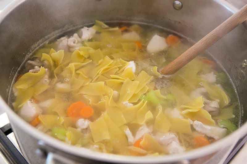 Egg noodles mixed into a homemade chicken soup.