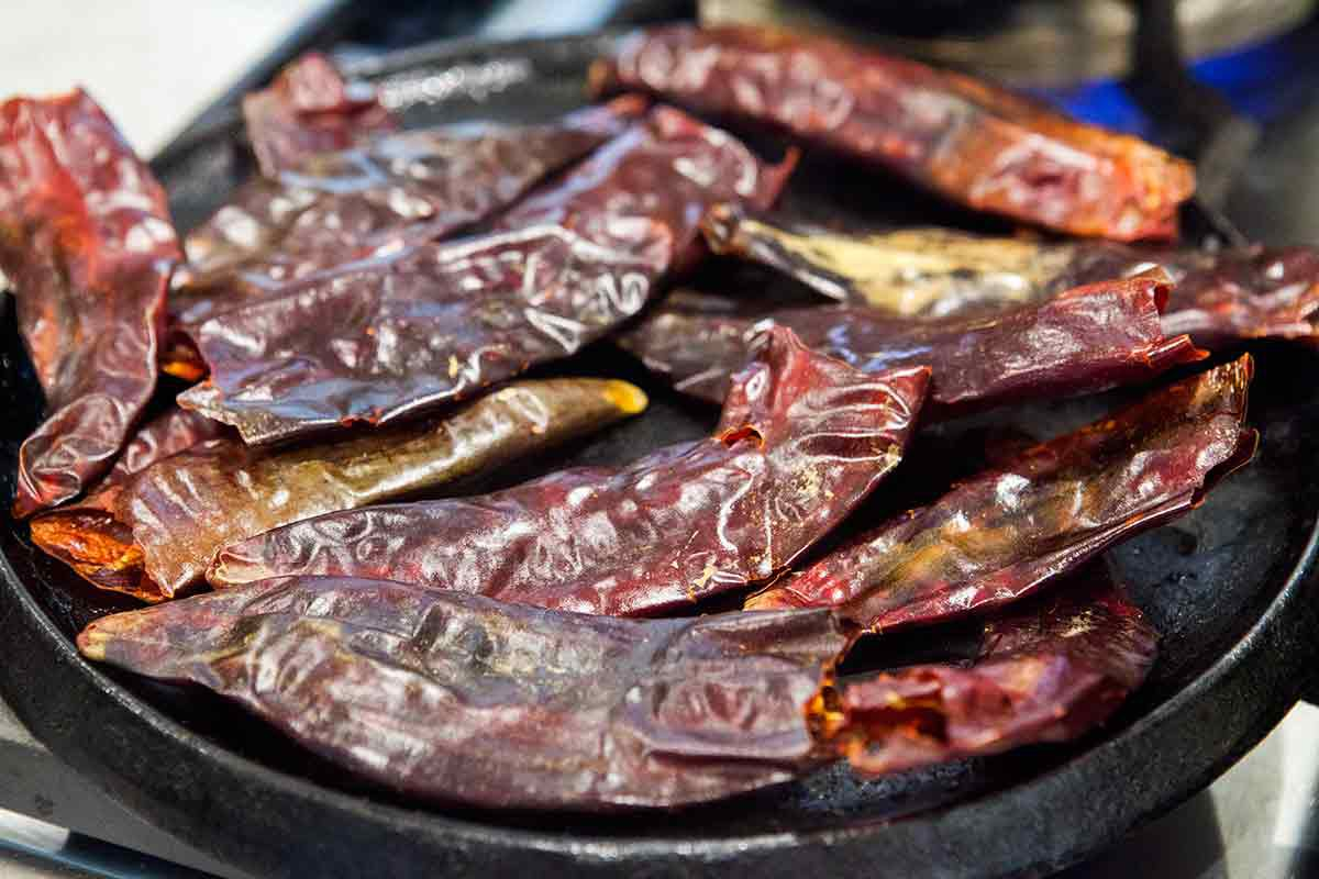 Roast the dried red chilies until fragrant and softened for the red chili pozole