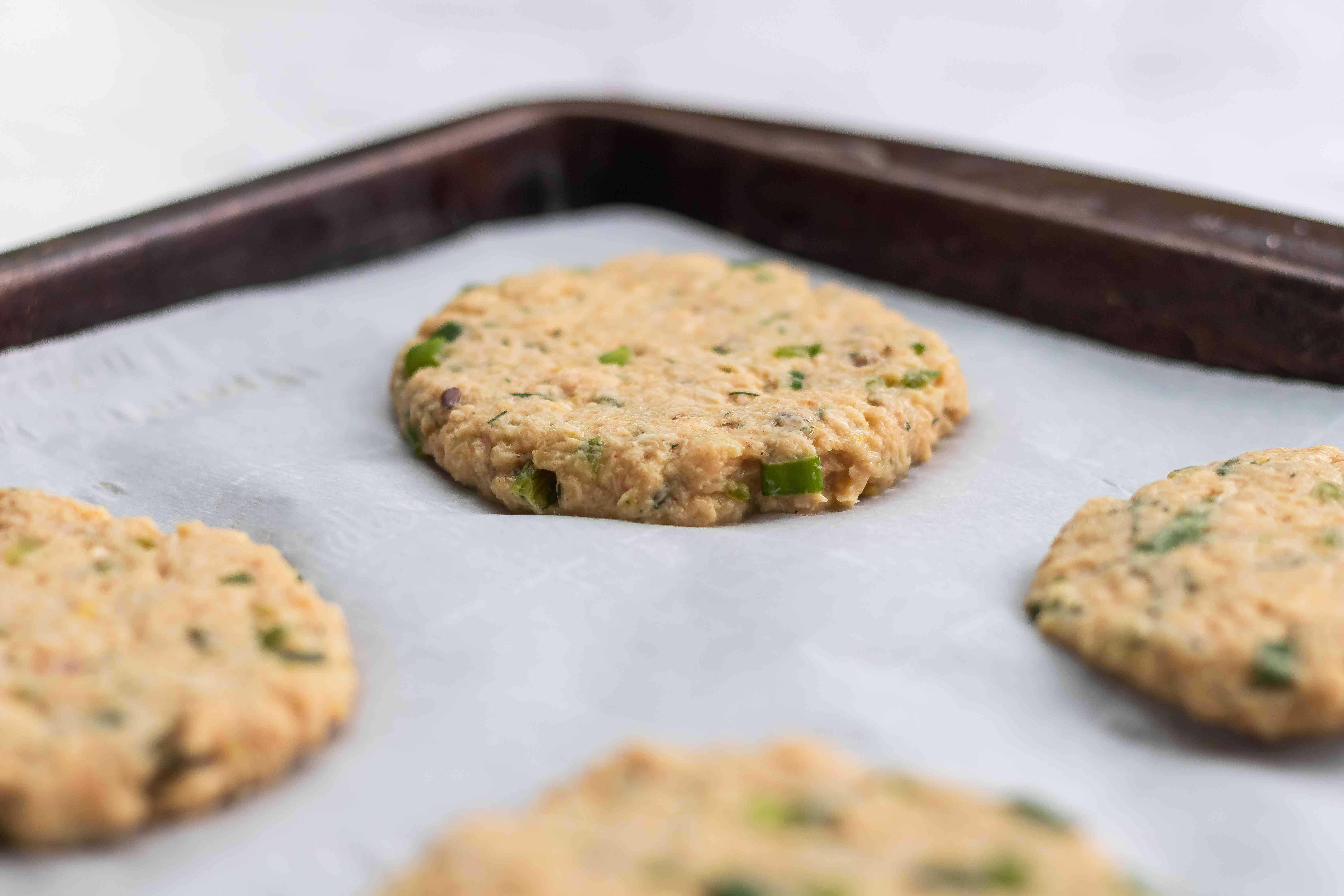 How to make salmon cakes and portioned on parchment paper.