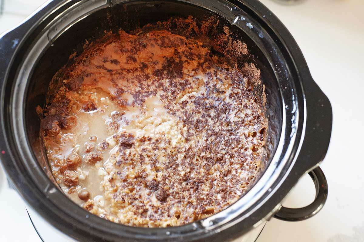 Slow Cooker Steel Cut Oatmeal cooking in a slow cooker.
