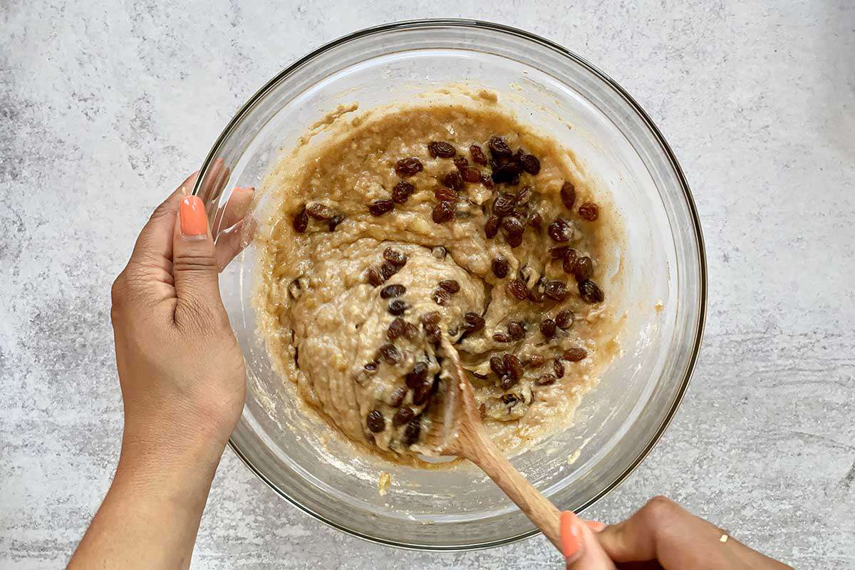 Jamaican Banana Bread batter getting the rum soaked raisins stirred into it.