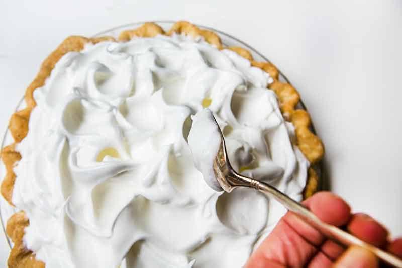 Adding meringue topping to lemon meringue pie