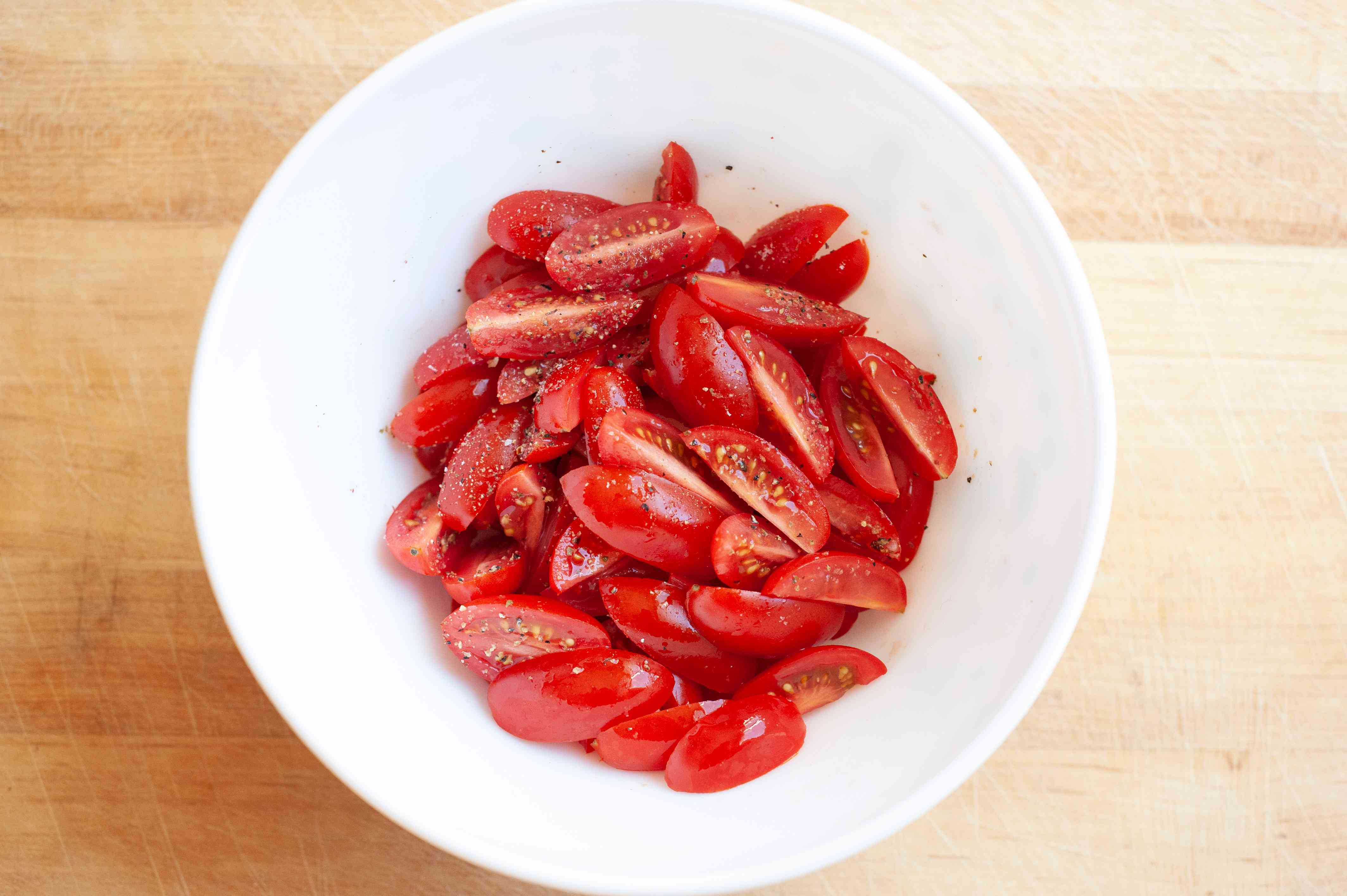Sliced grape tomatoes to make a summery blt pasta.