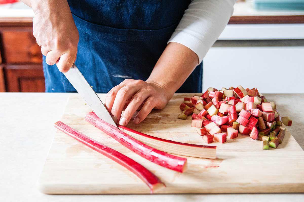 Rhubarb Custard Pie with Orange Zest - slicing rhubarb stalks
