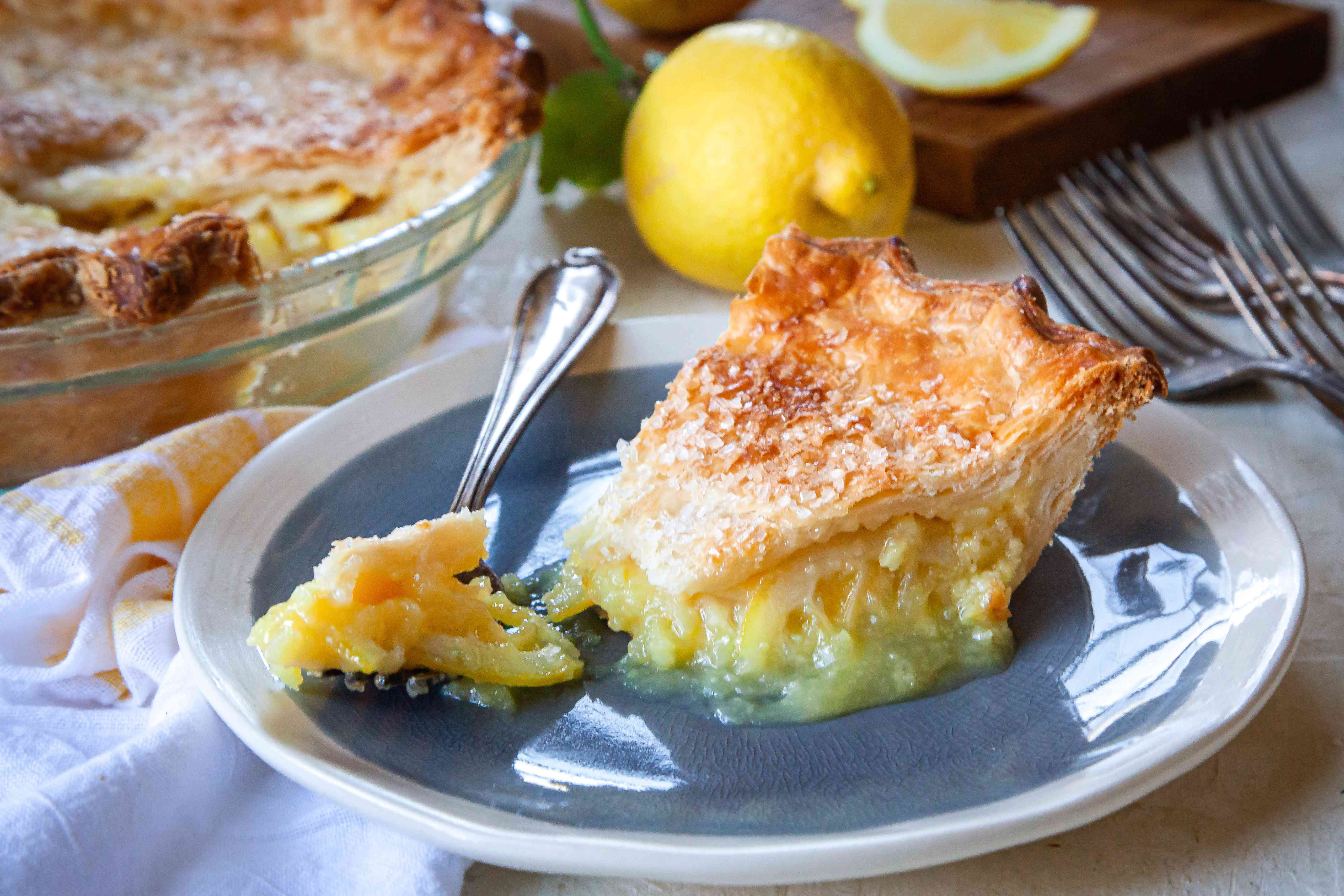 A slice of Ohio Lemon Pie with a forkful on a plate.