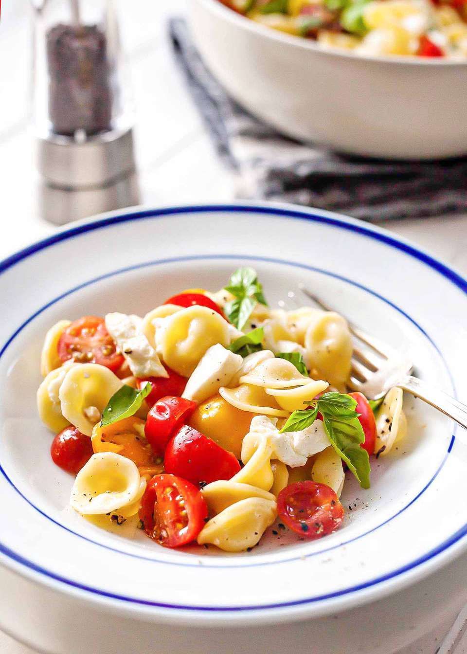 Caprese Salad with Cherry Tomatoes - bowl of caprese salad with pasta
