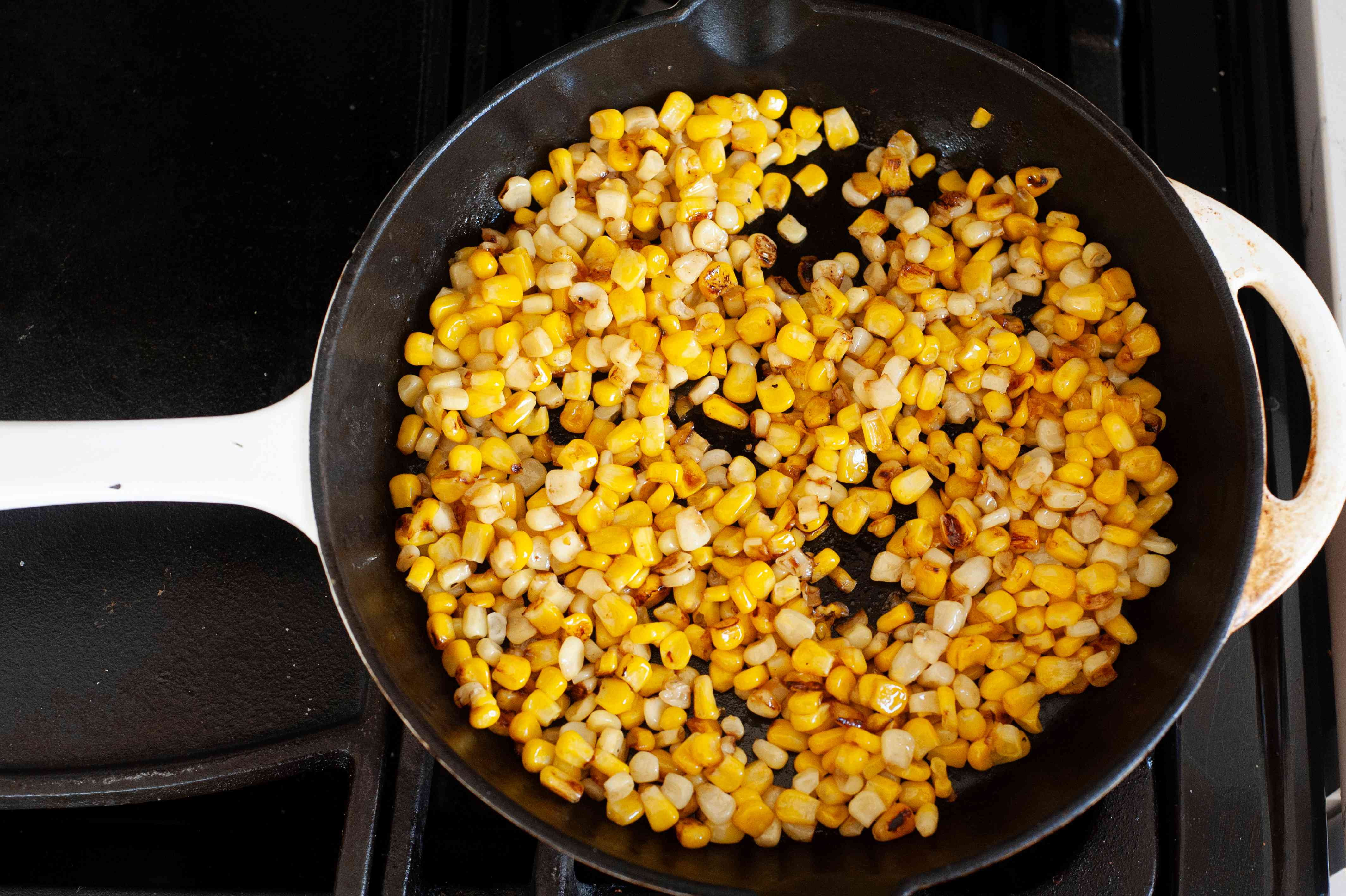Corn in a skillet to make Tex-Mex Chopped Chicken Salad with Cilantro Lime Vinaigrette.