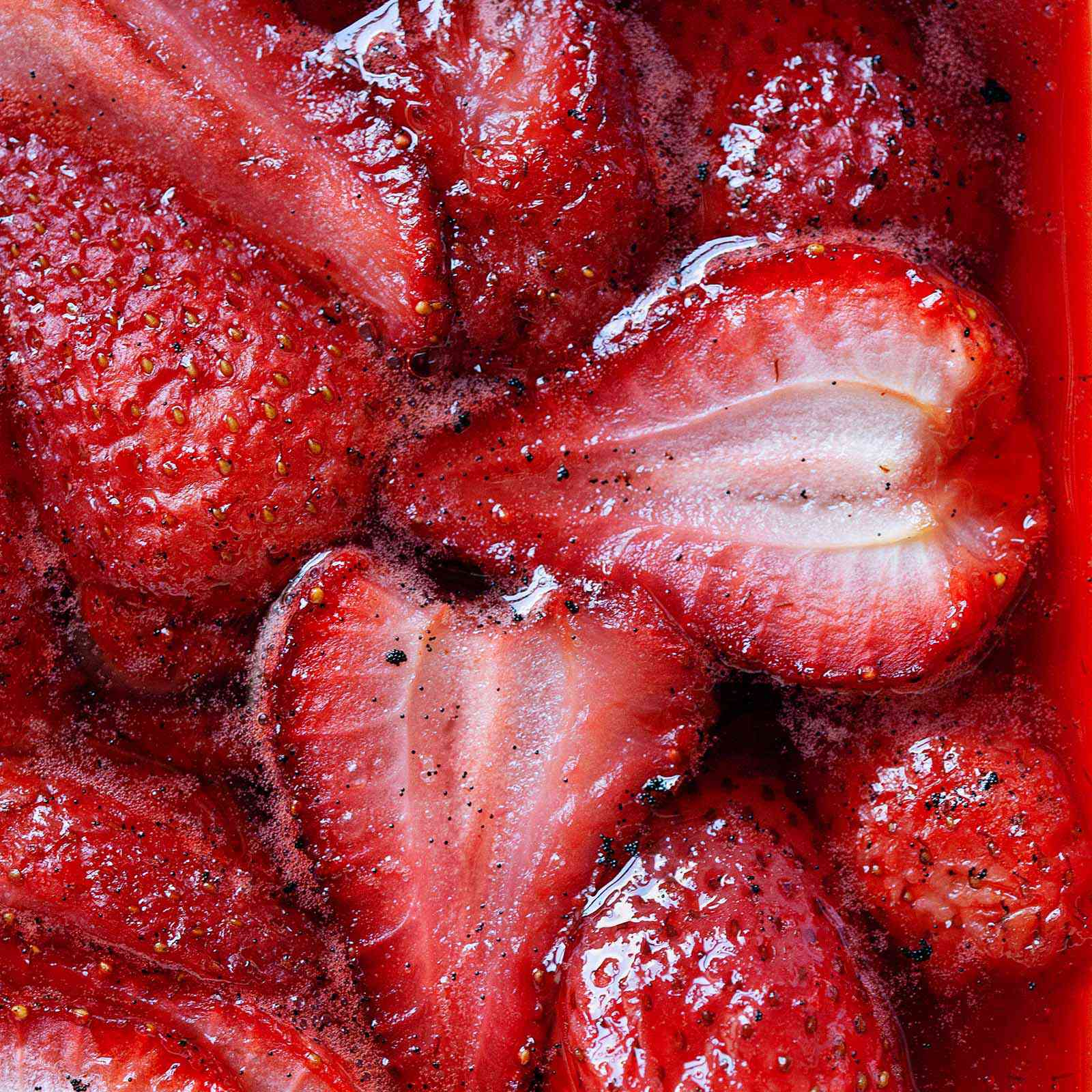 Close up of strawberry topping for ice cream in its own syrup.