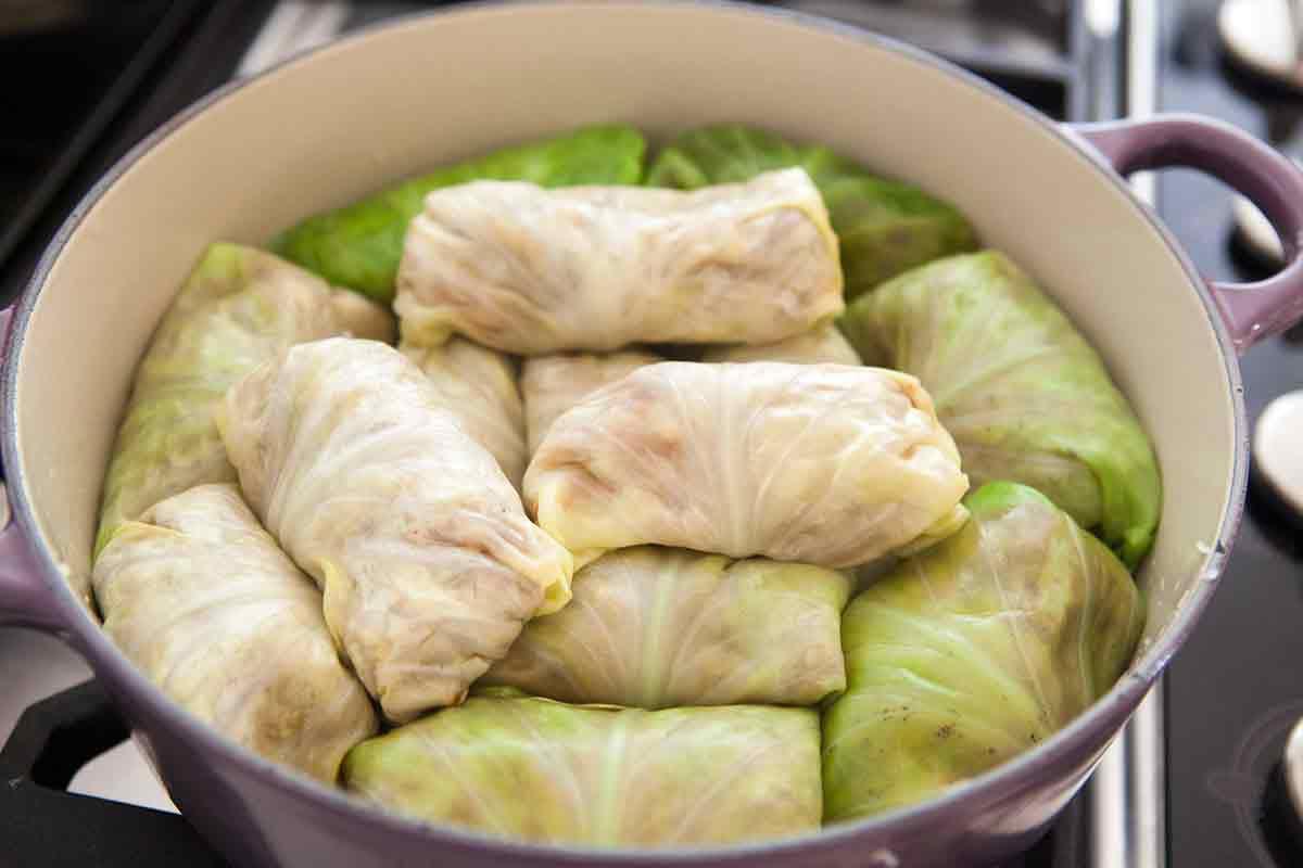 add the stuffed cabbage rolls on top of the sauerkraut