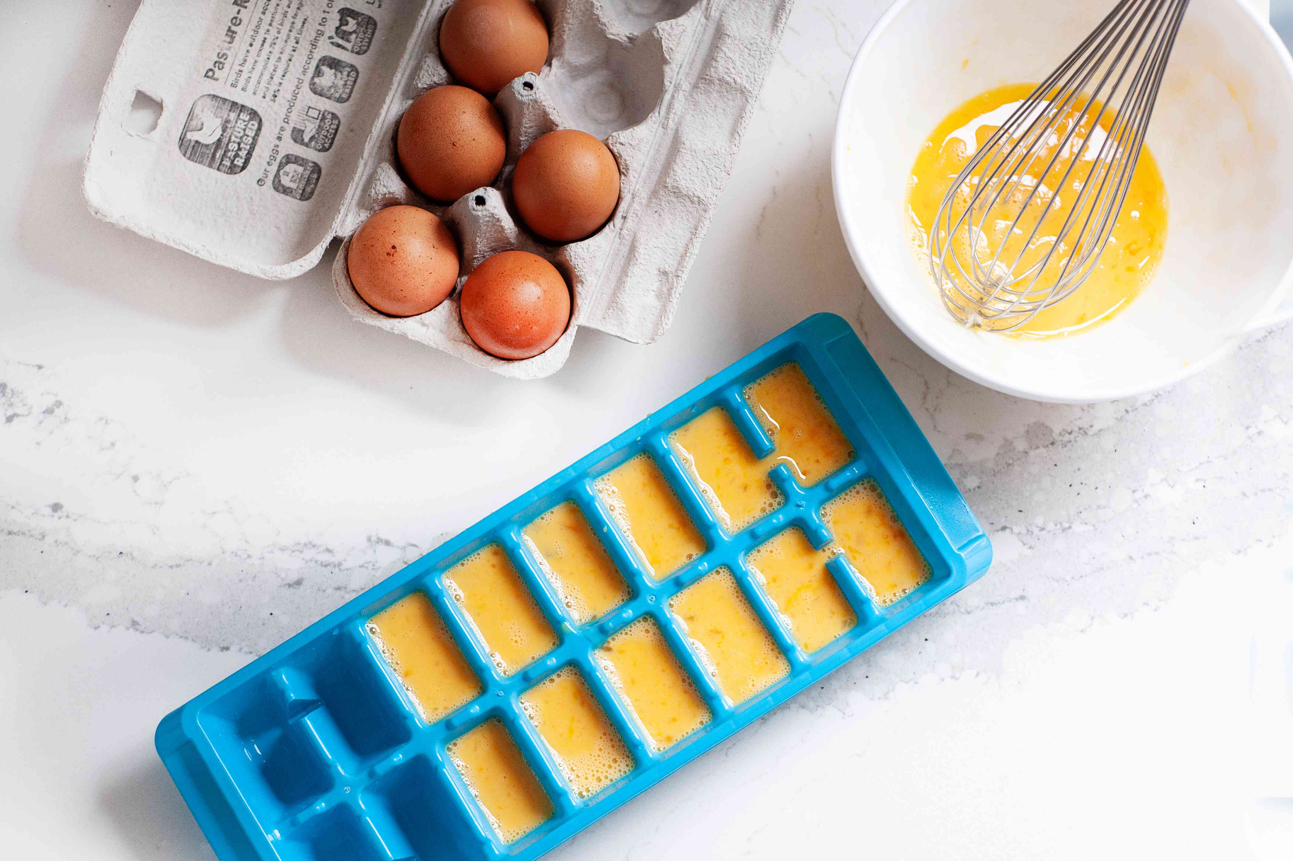 Eggs frozen in an ice cube tray.