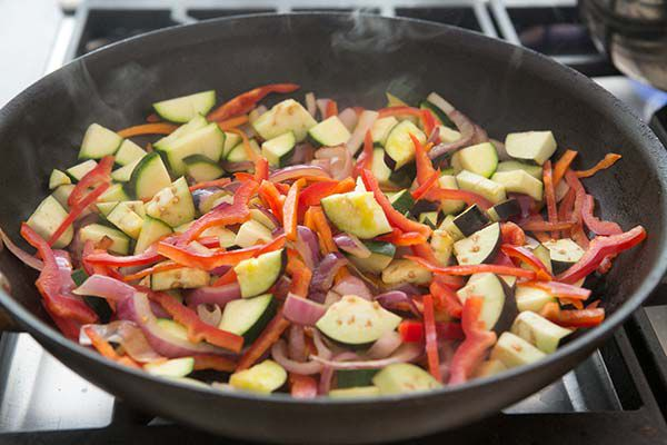 zucchini, peppers, and onion in skillet