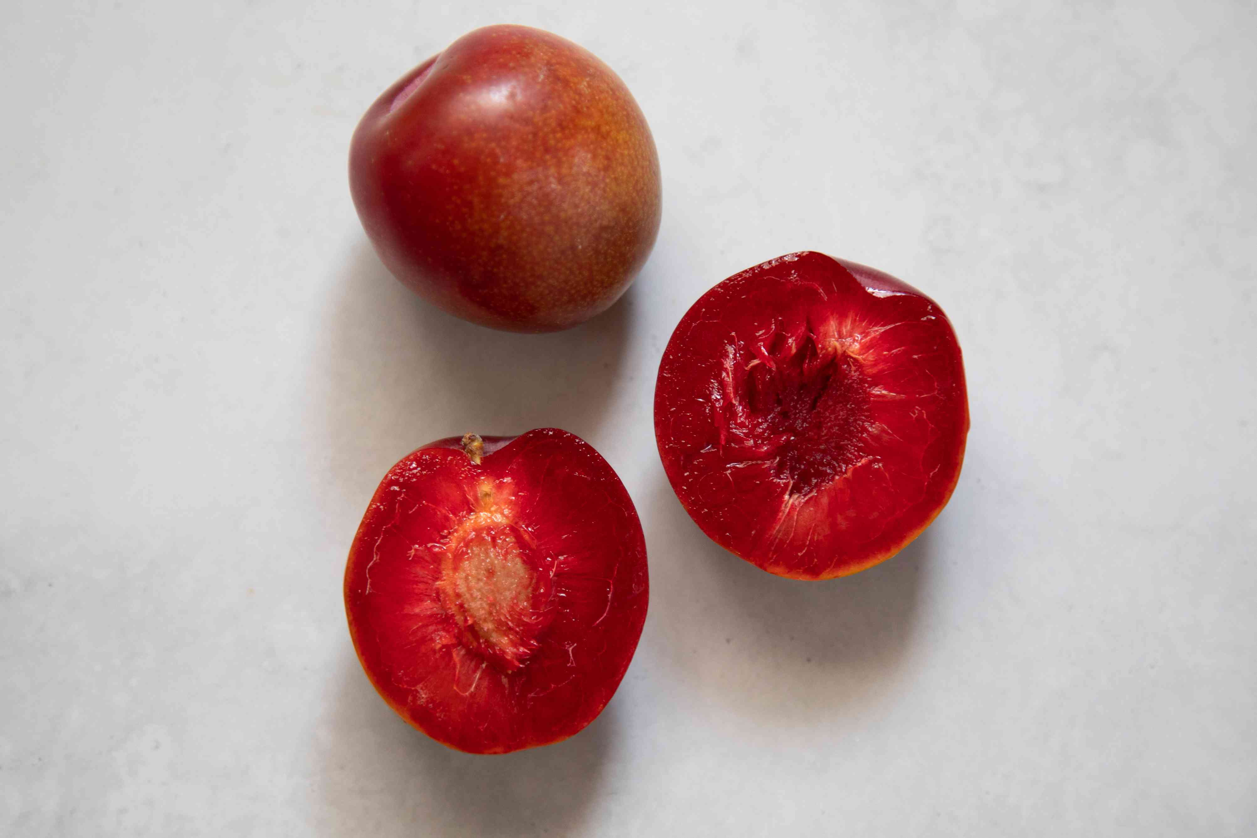 Opened plum showing pit