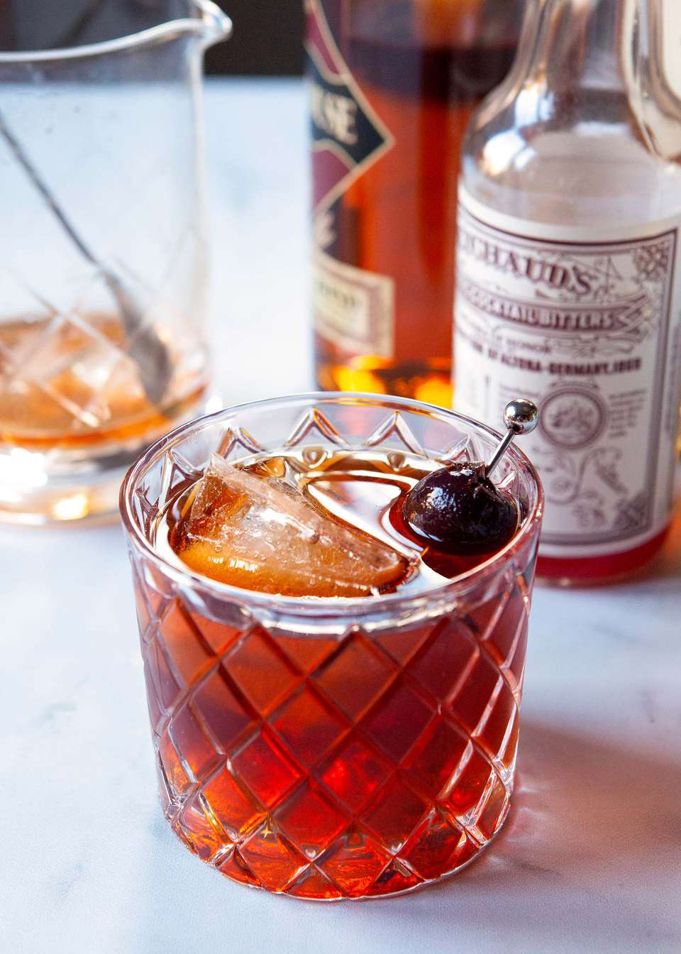 A Vieux carre is set in front of ingredients to make the cocktail.