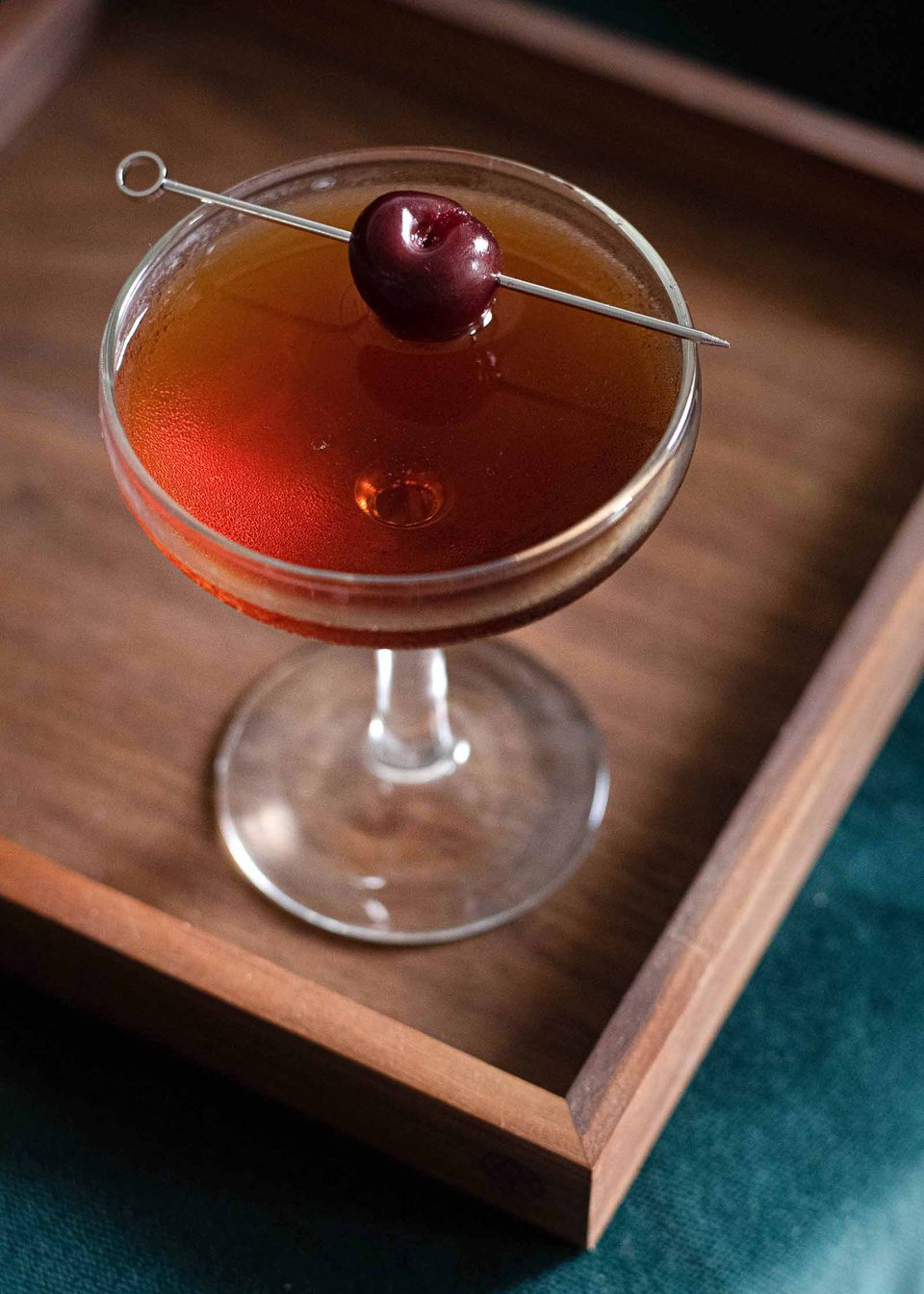 Manhattan cocktail rye whiskey, sweet vermouth, bitters in a coupe glass