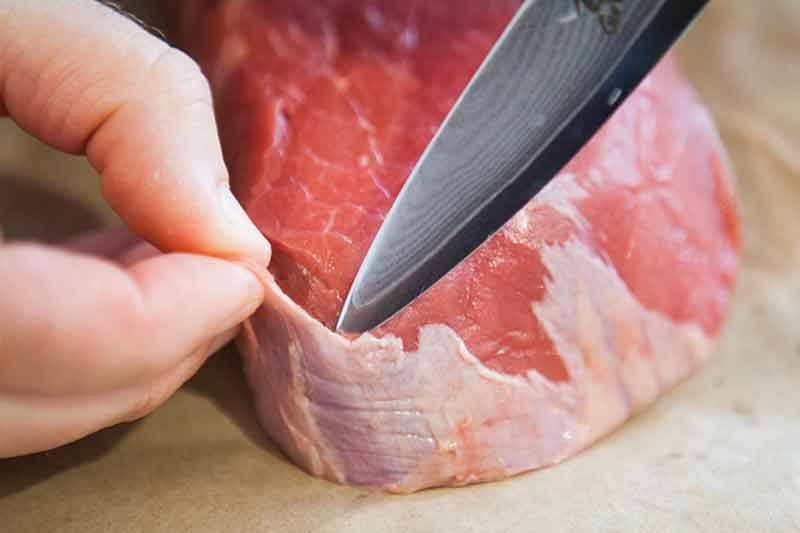 Cutting away tough tissue for London Broil