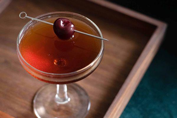 Manhattan cocktail with cherry garnish