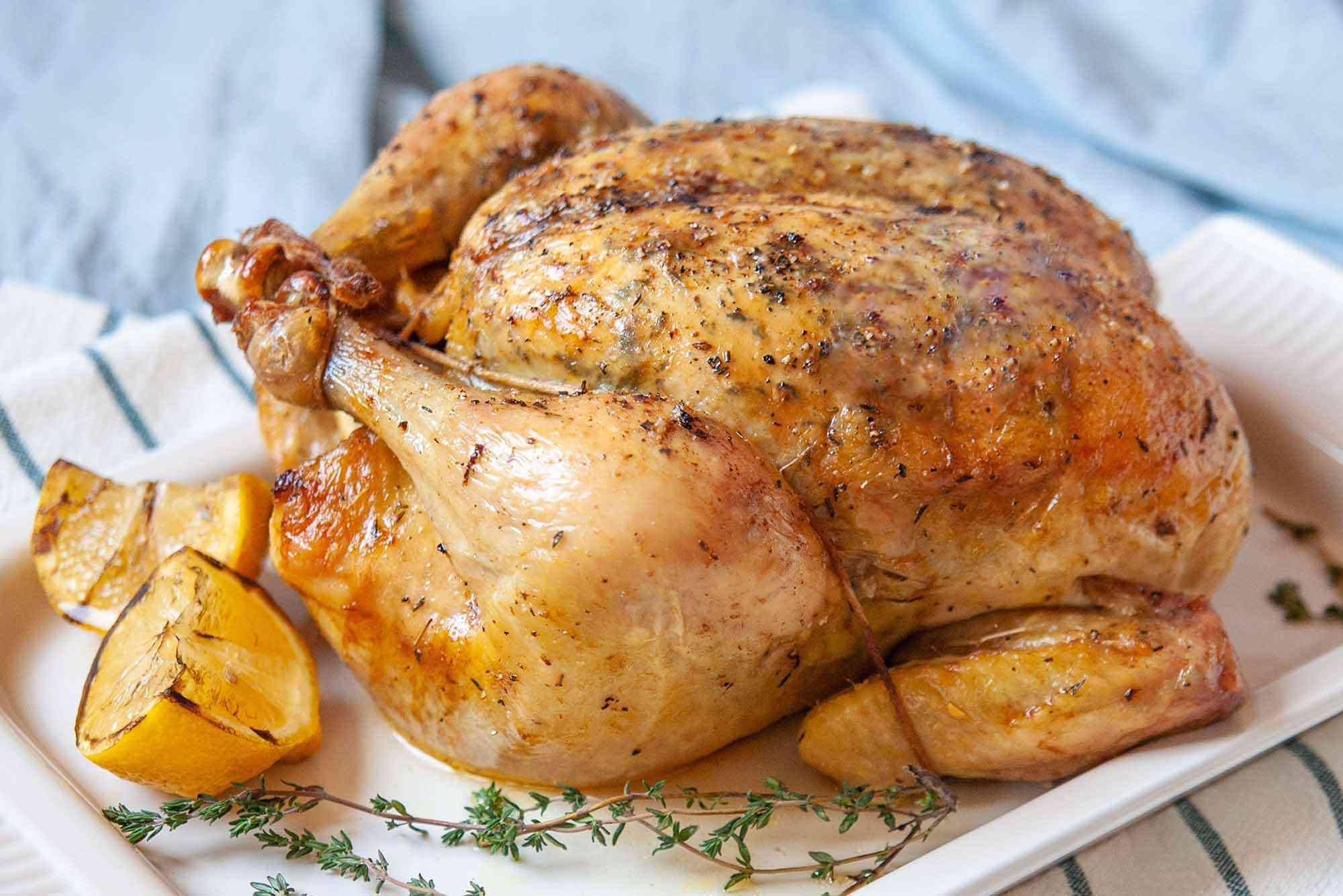 Dry Brined Roast Chicken - - whole chicken on platter Recipe