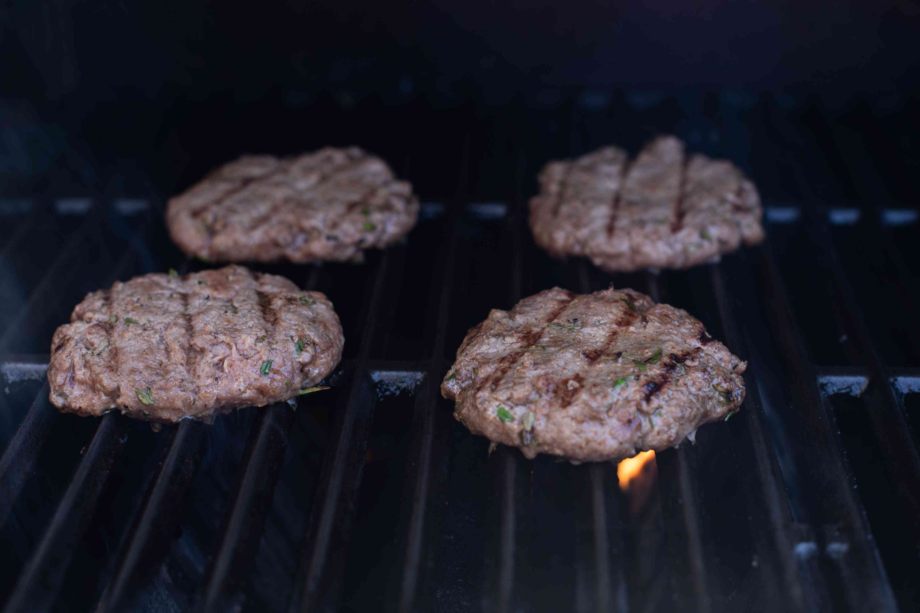 Grilling burgers to make a famous burger.