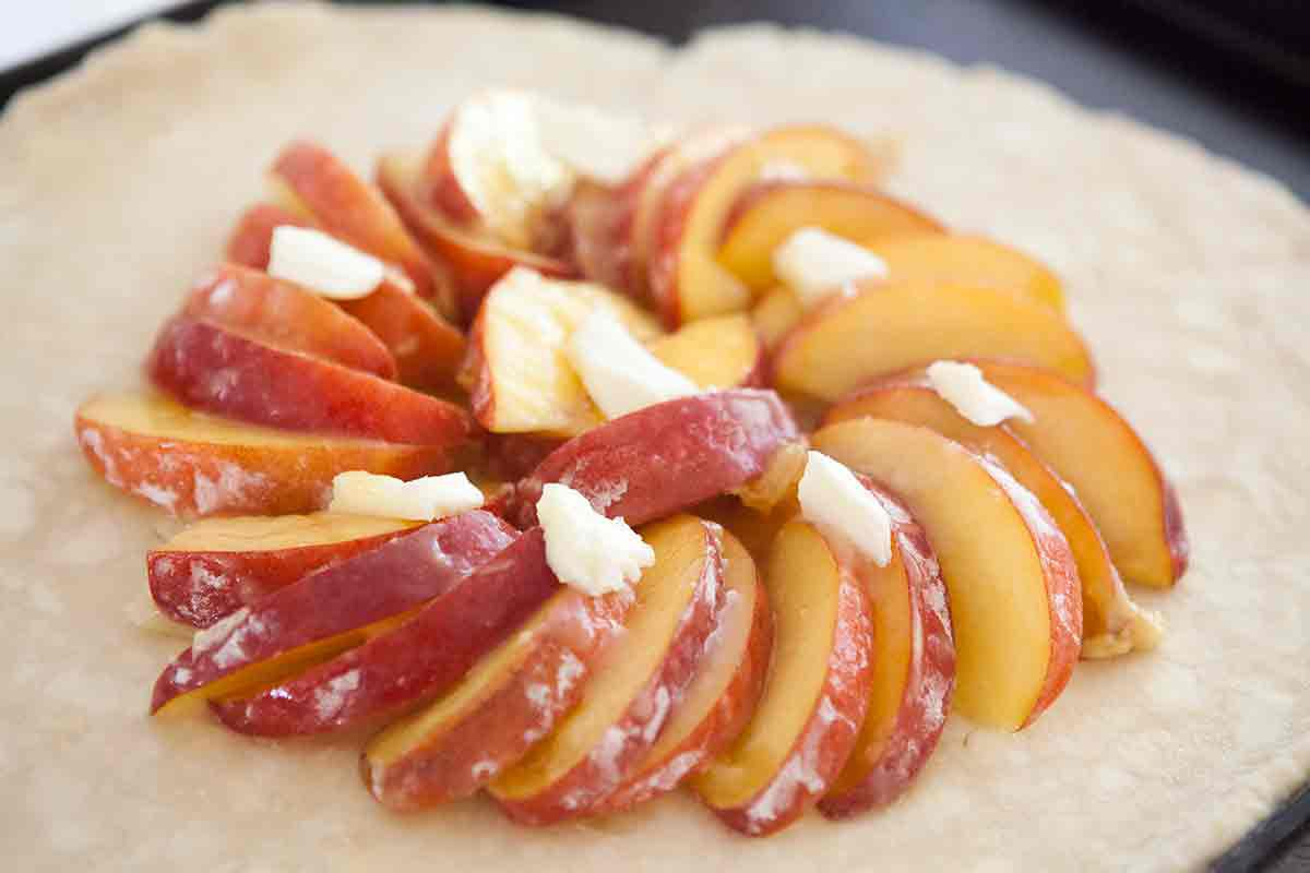 arrange peaches and dot with butter for the galette