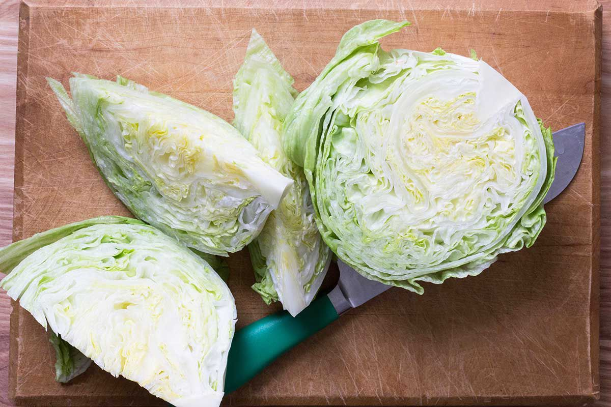 How to make a wedge salad by slicing iceberg lettuce into wedges.