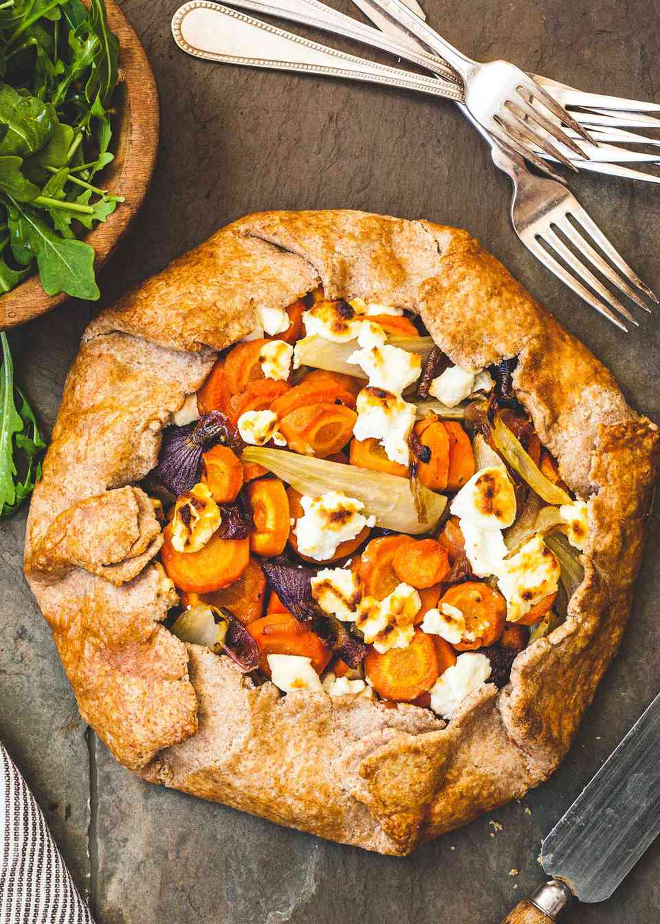 Savory Vegetable Tart with forks and a salad.