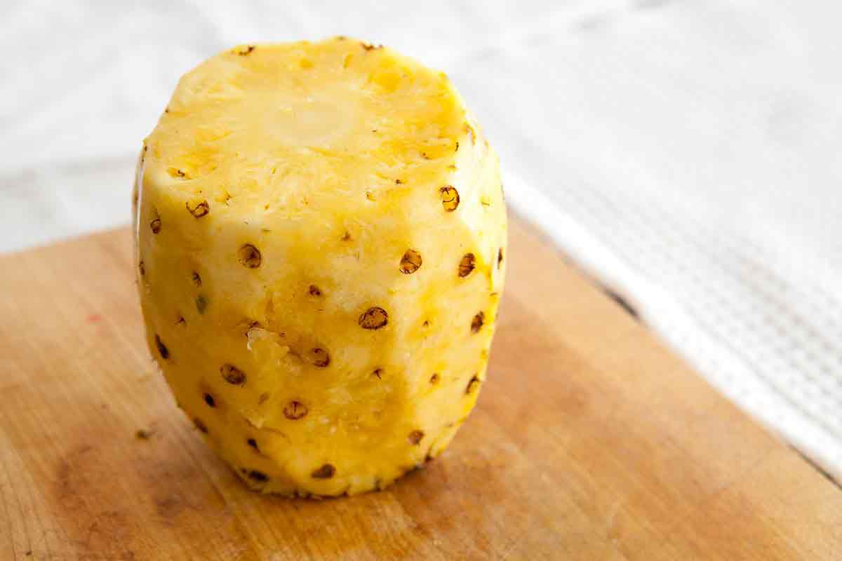 pineapple with skin cut, eyes still need to be removed
