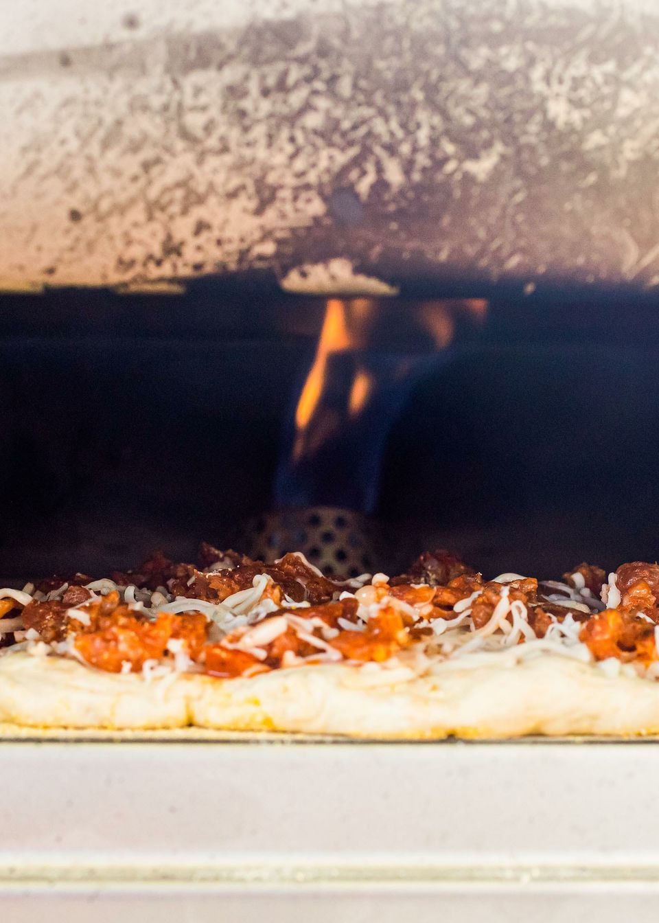 What is the Roccbox? This photo shows a pizza cooking inside with the fire visible.