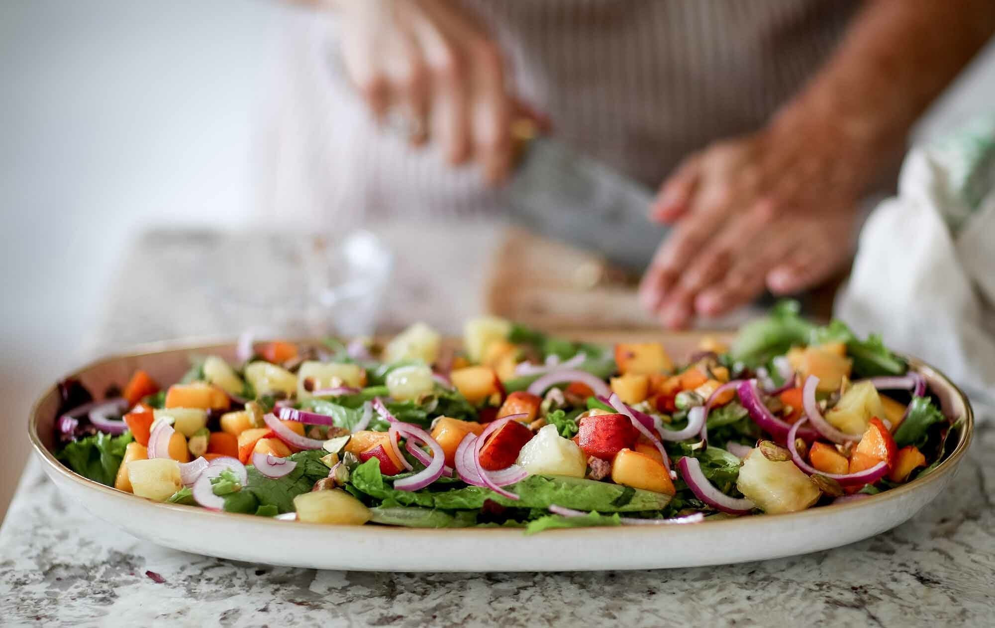 Side salad recipe with peaches, goat cheese, and pistachios