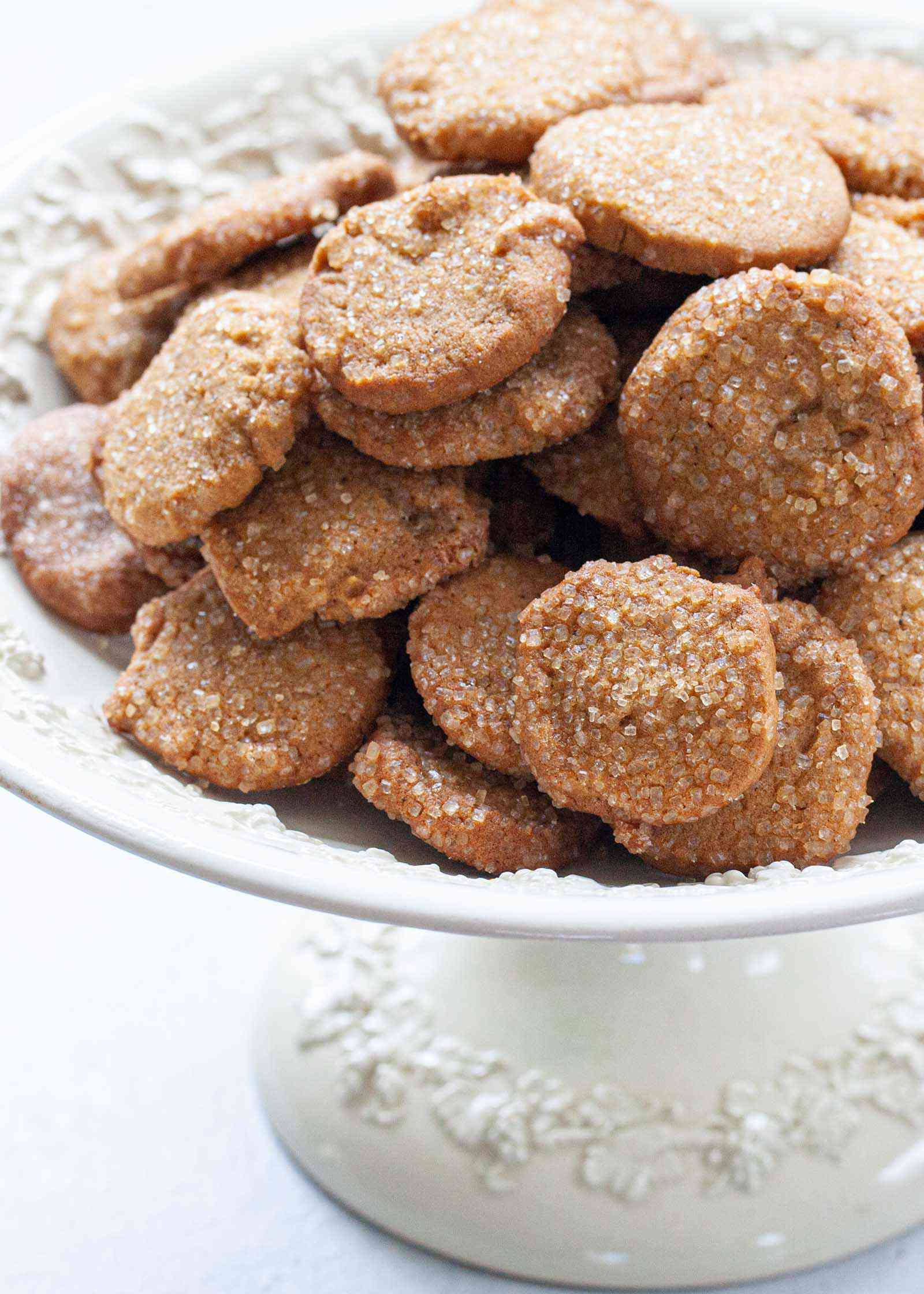 A footed serving bowl with Easy Ginger Lemon Cookies stacked on top.