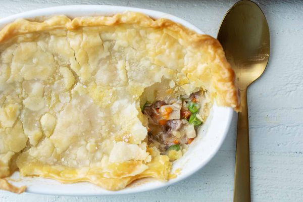 Leftover turkey pot pie in a large casserole dish with serving spoon
