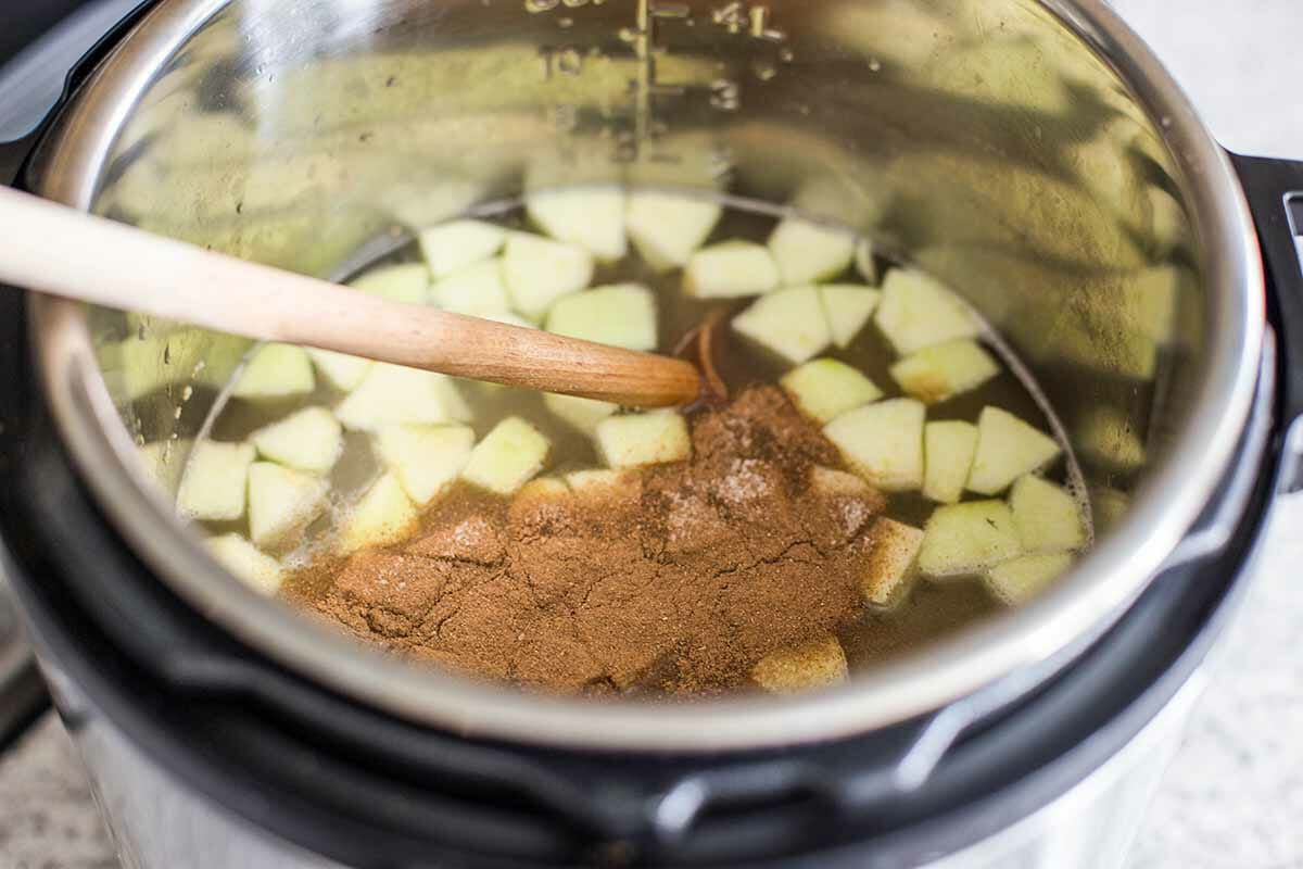 Add the liquid, apples, and cinnamon to the instant pot for instant pot oatmeal
