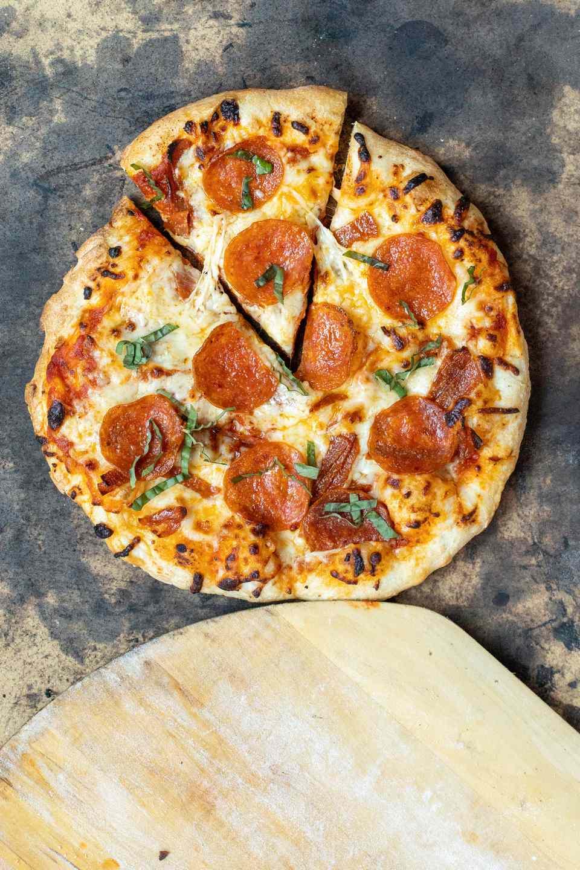 Pepperoni pizza on burned pizza stone
