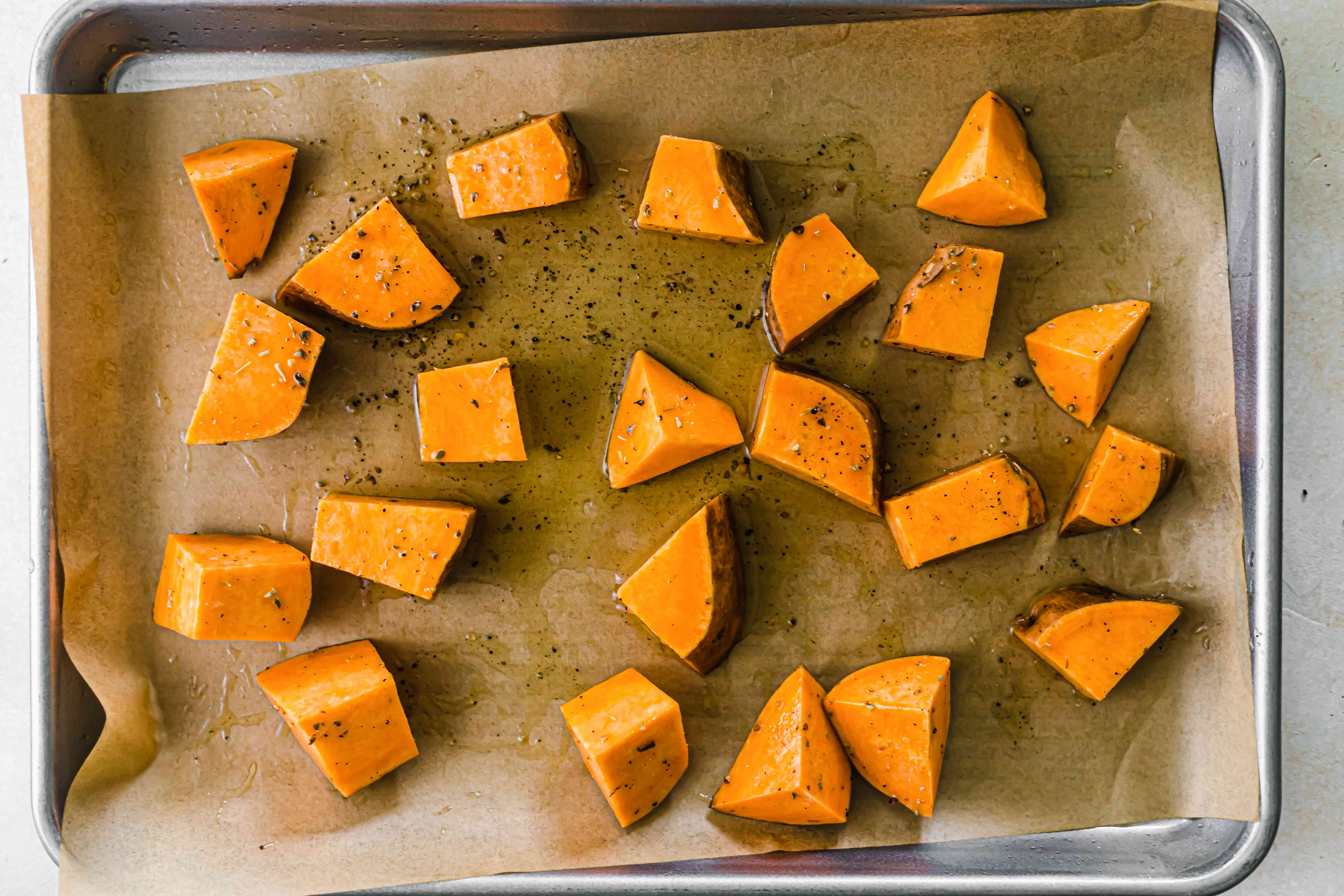 Cut sweet potatoes on parchment how to roast any vegetable