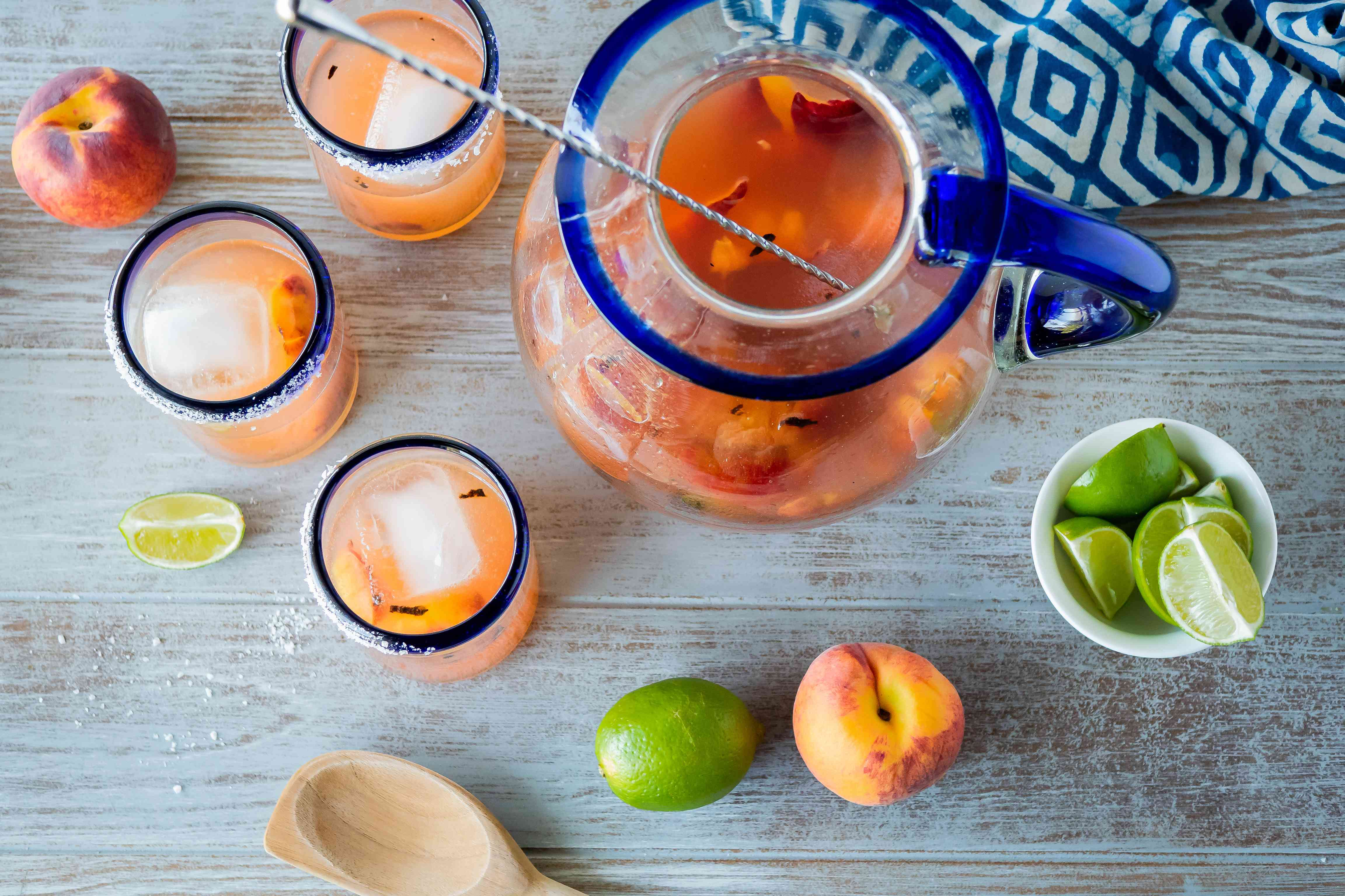 Overhead view of peach margaritas made with grilled peaches.