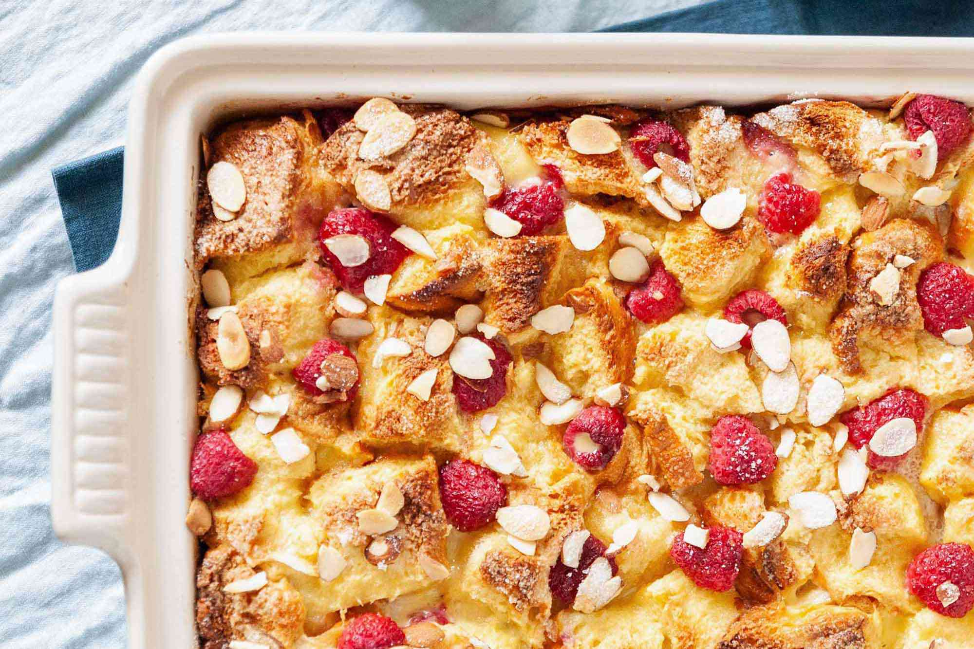 Overnight French Toast Casserole - french toast casserole with raspberries and almonds in baking dish