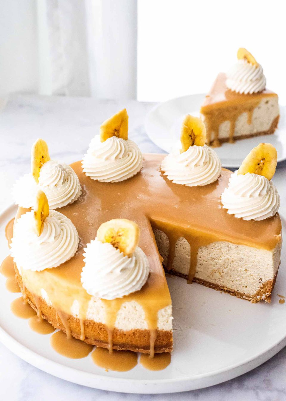Baked Banoffee Cheesecake Pie pie with toffee sauce on platter