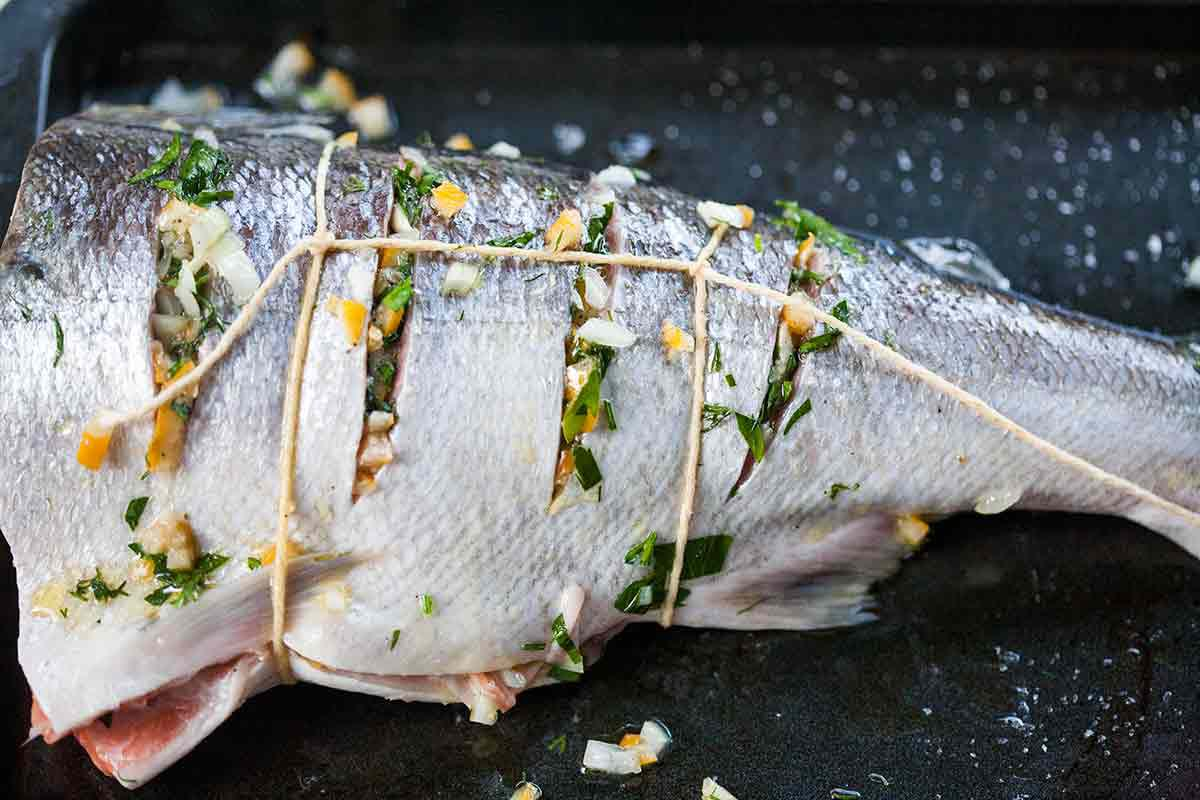 Stuff salmon cuts with preserved lemon relish for grilled whole salmon