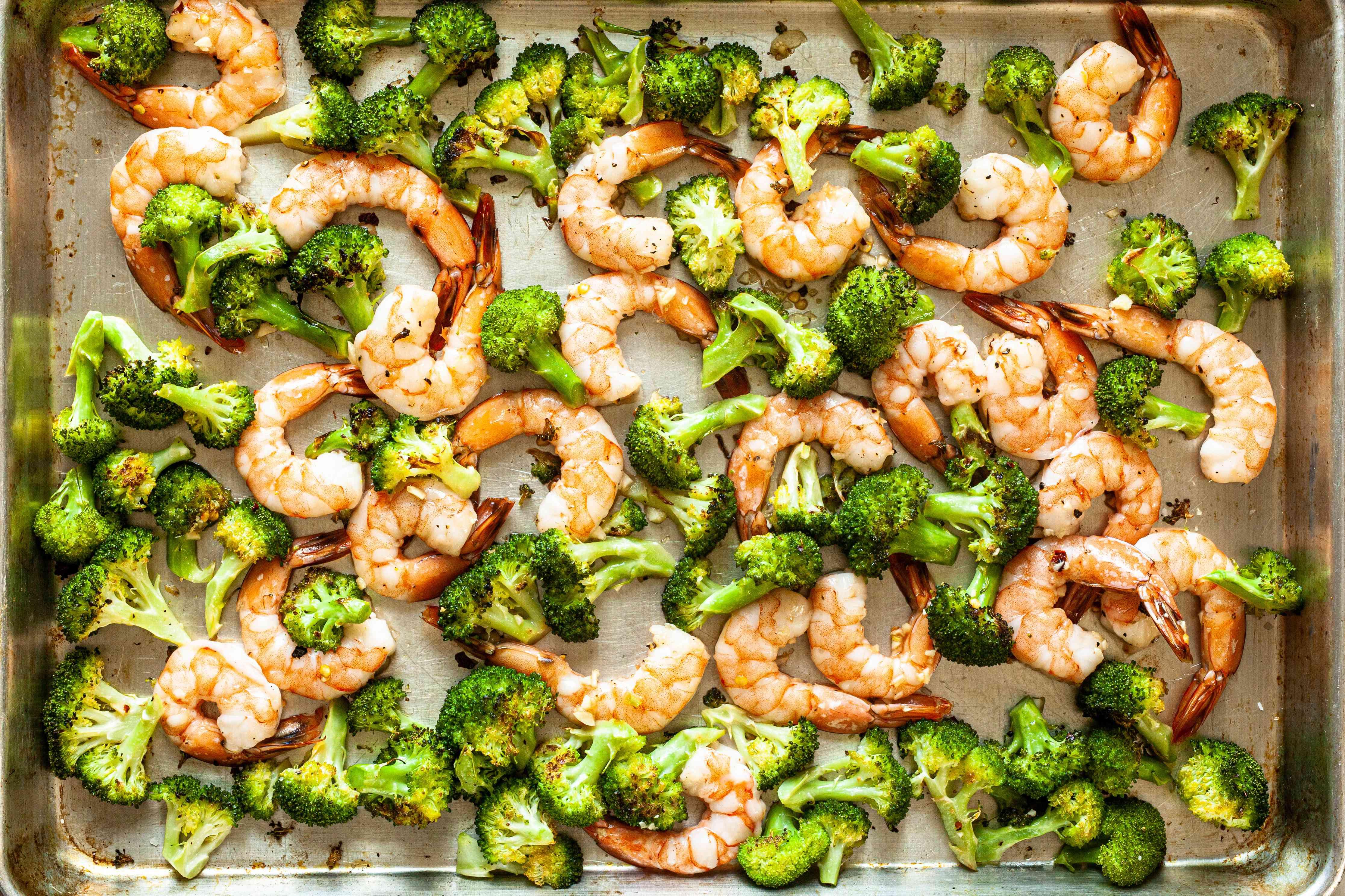 Broccoli and shrimp on a sheet pan to make Easy Sheet Pan Shrimp and Broccoli.