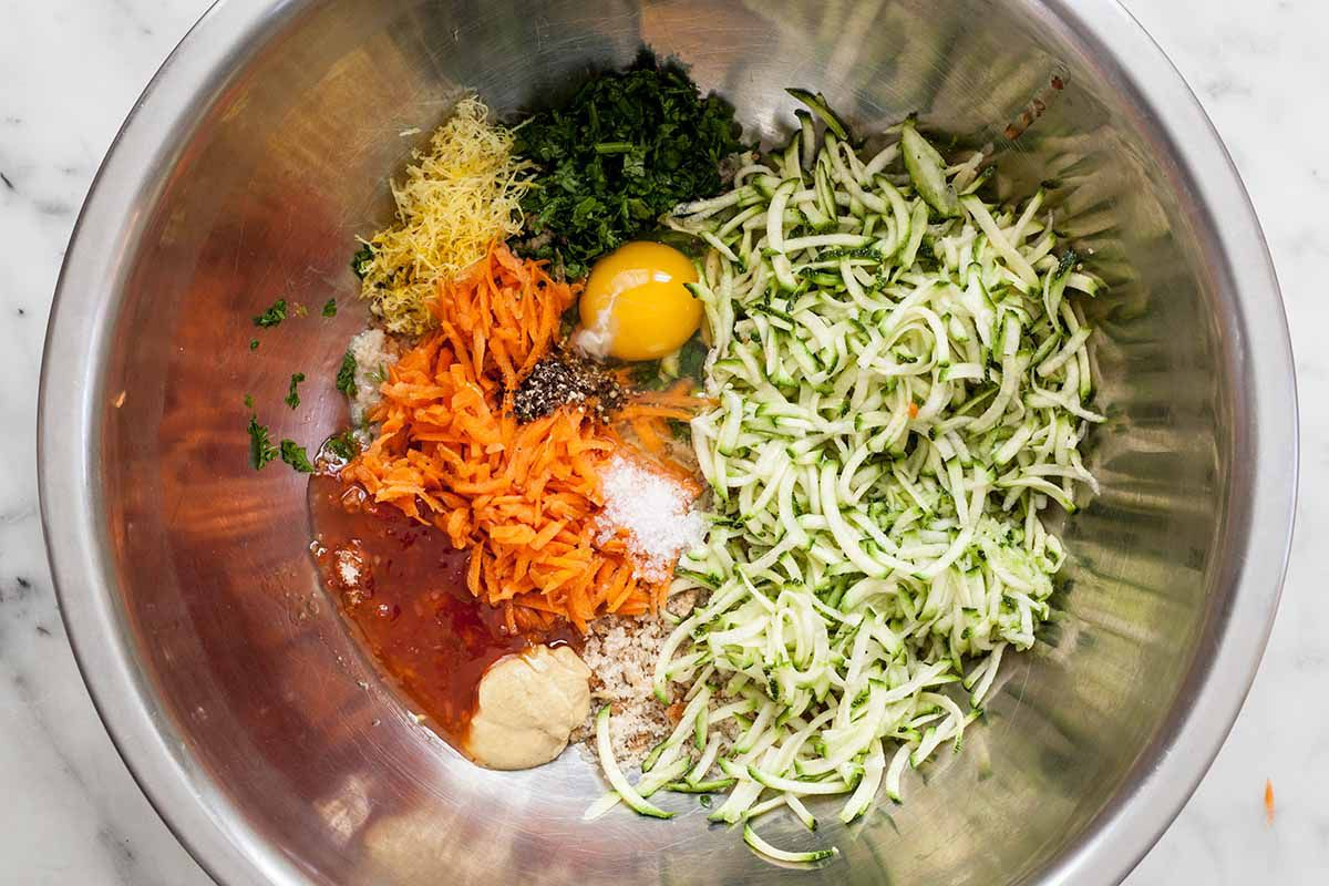 Ingredients for Turkey Meatloaf: sandwich bread, egg, salt and pepper, grated zucchini, grated carrot, grated onion, parsley, lemon zest and juice, mustard