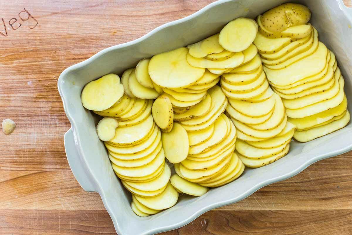 Smoked Sausage and Potato Bake layer the potatoes
