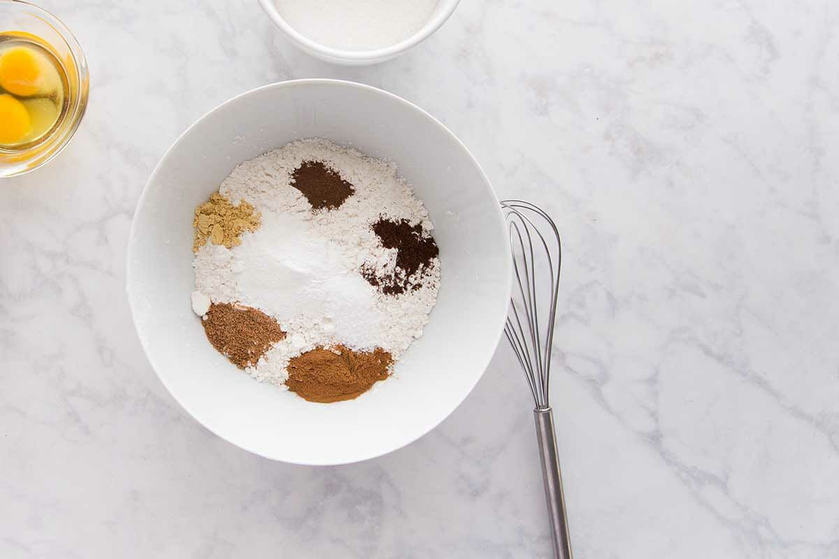 Flour and spices in a mixing bowl to make The Best Pumpkin Cake with Cream Cheese Frosting.