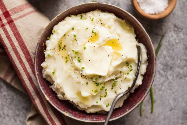 Make Ahead Mashed Potatoes Slow Cooker potatoes in a dish with butter and a napkin