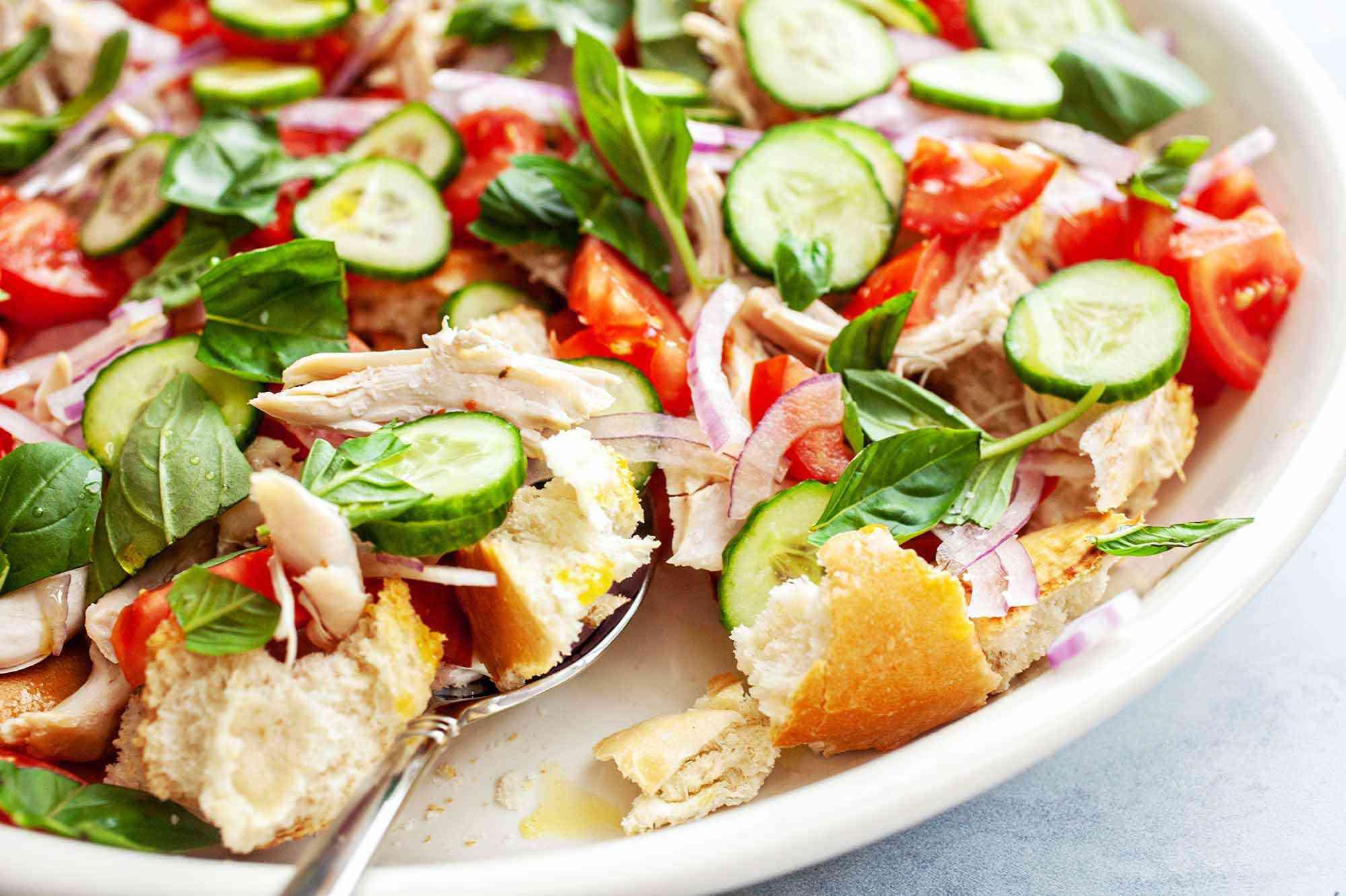 Summer Panzanella Salad - bread pieces on spoon