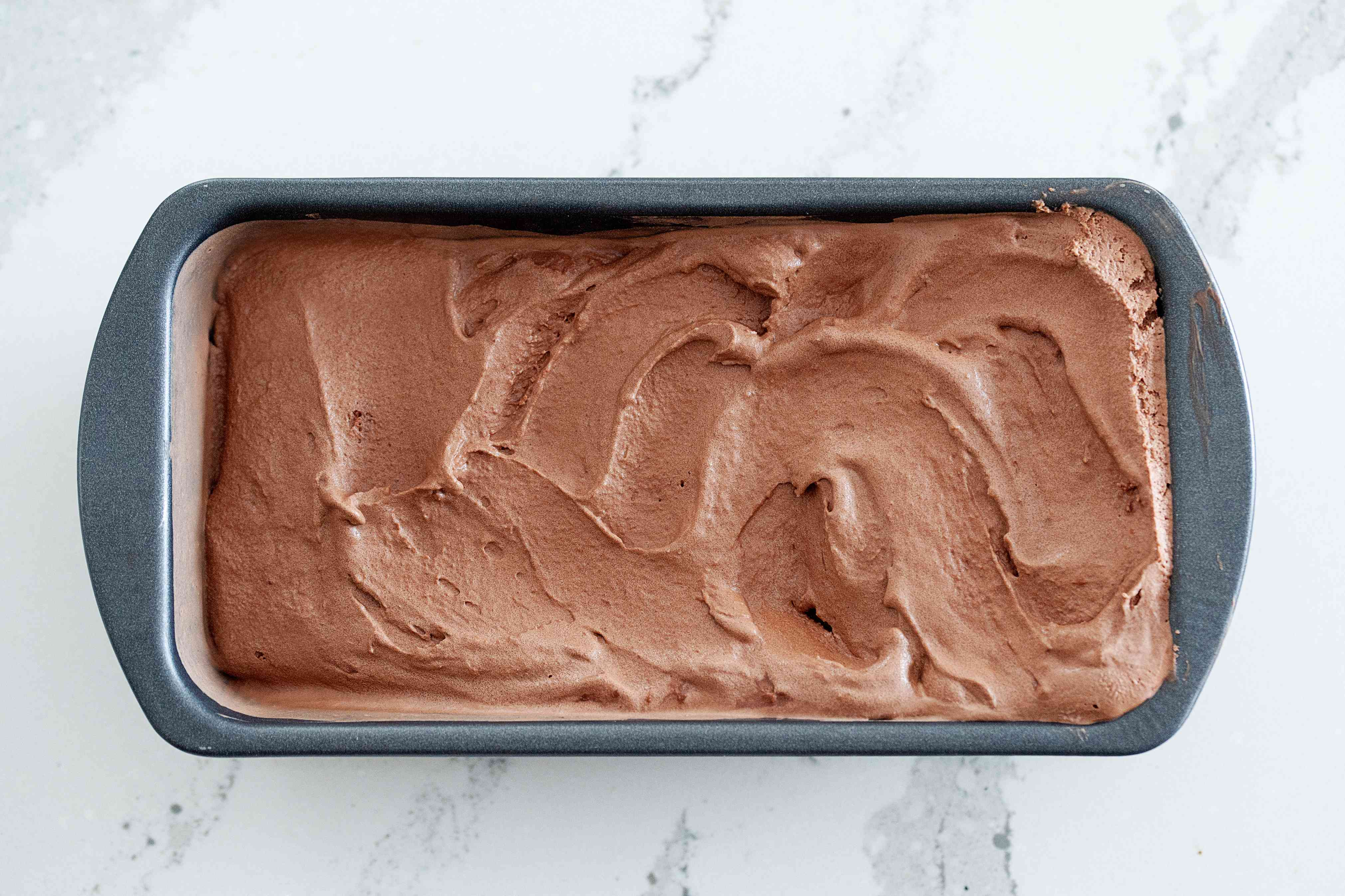 Chocolate ice cream in a loaf pan.