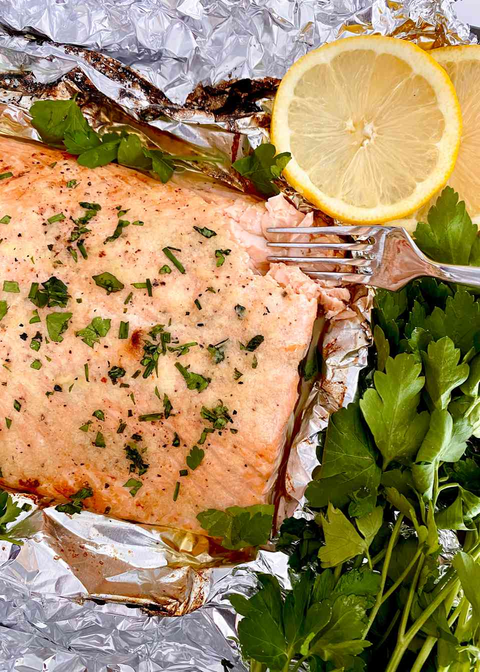 Garlic Butter Baked Salmon with herbs and lemon.