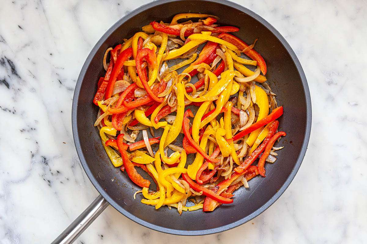 How to Make Shakshuka by sauteeing peppers in a pan.